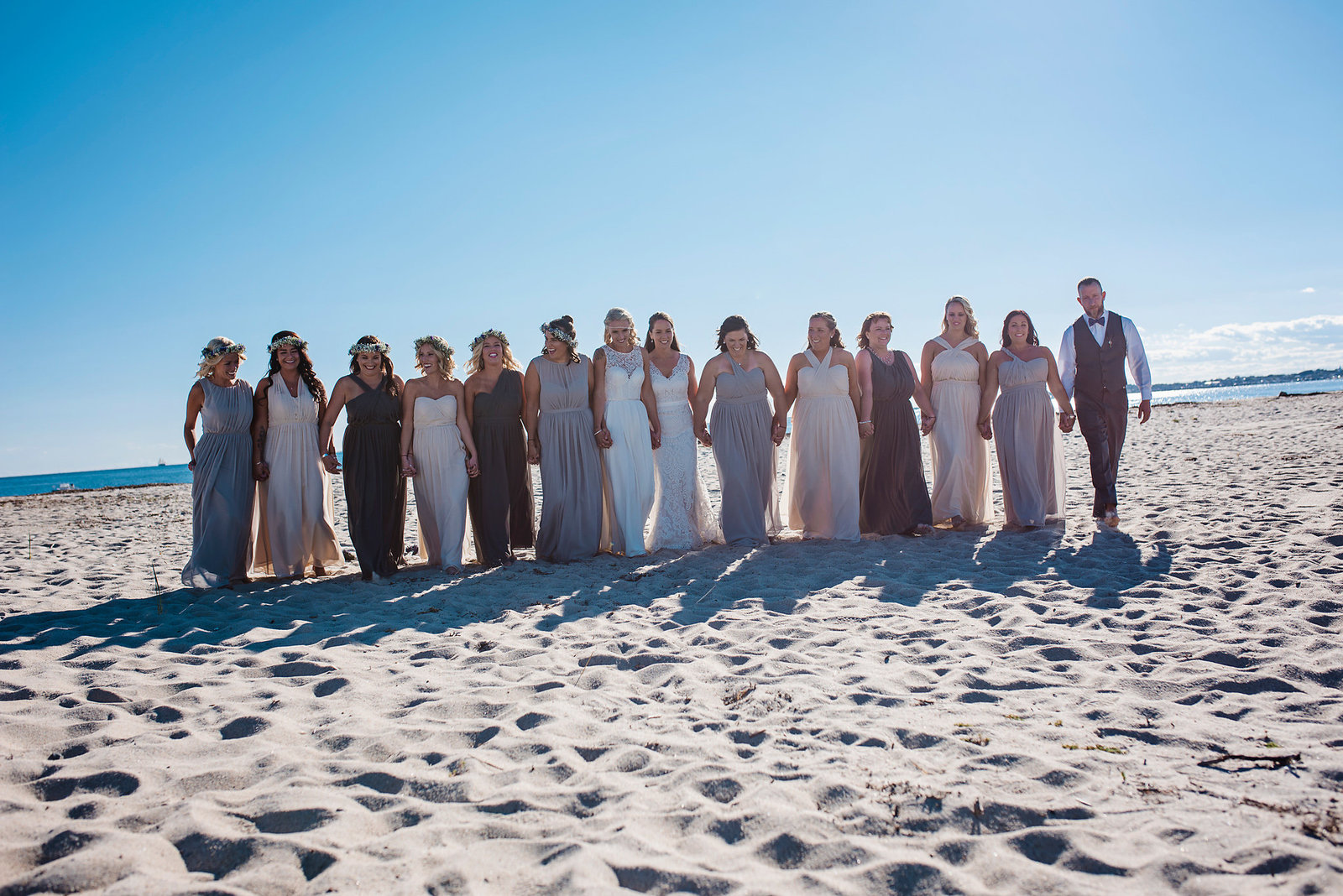 bridal party on beach, Cape Cod wedding, same sex wedding, two brides, bridesmaids with floral crowns