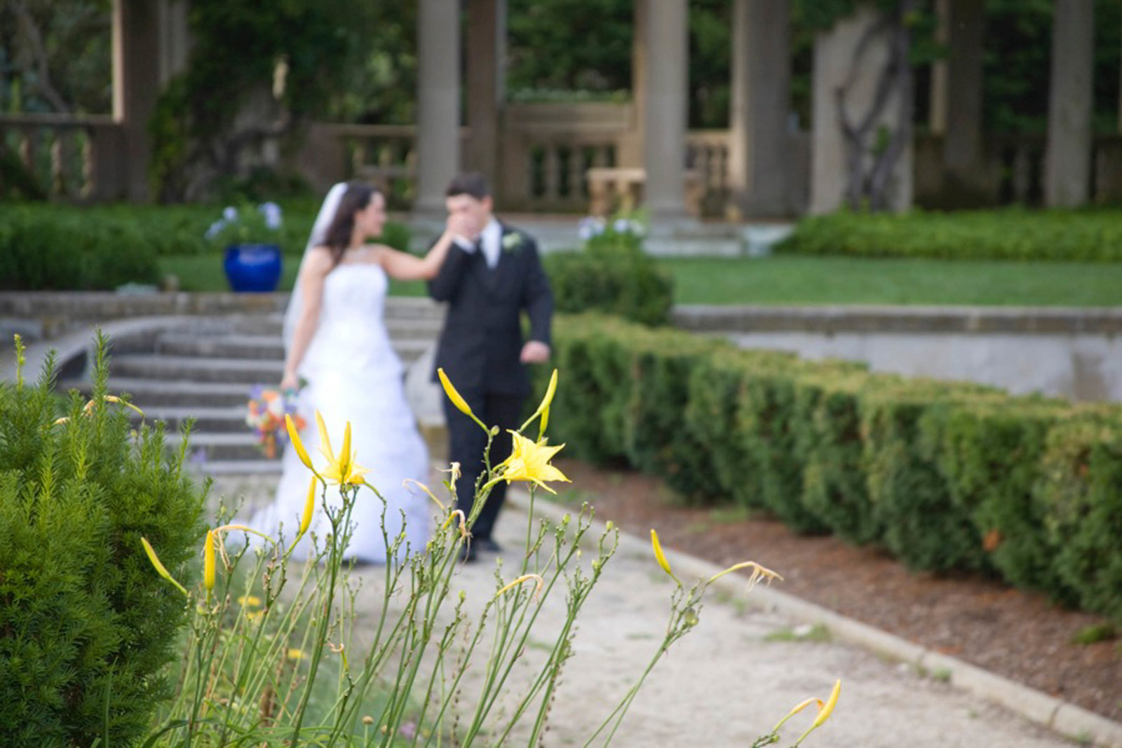 Bride and groom walking down a pathway