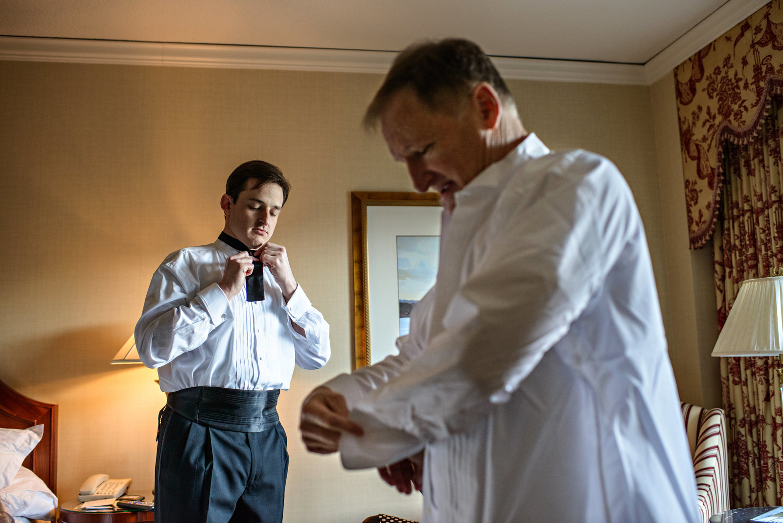 A groom gets ready with his dad at a hotel in Philadelphia.