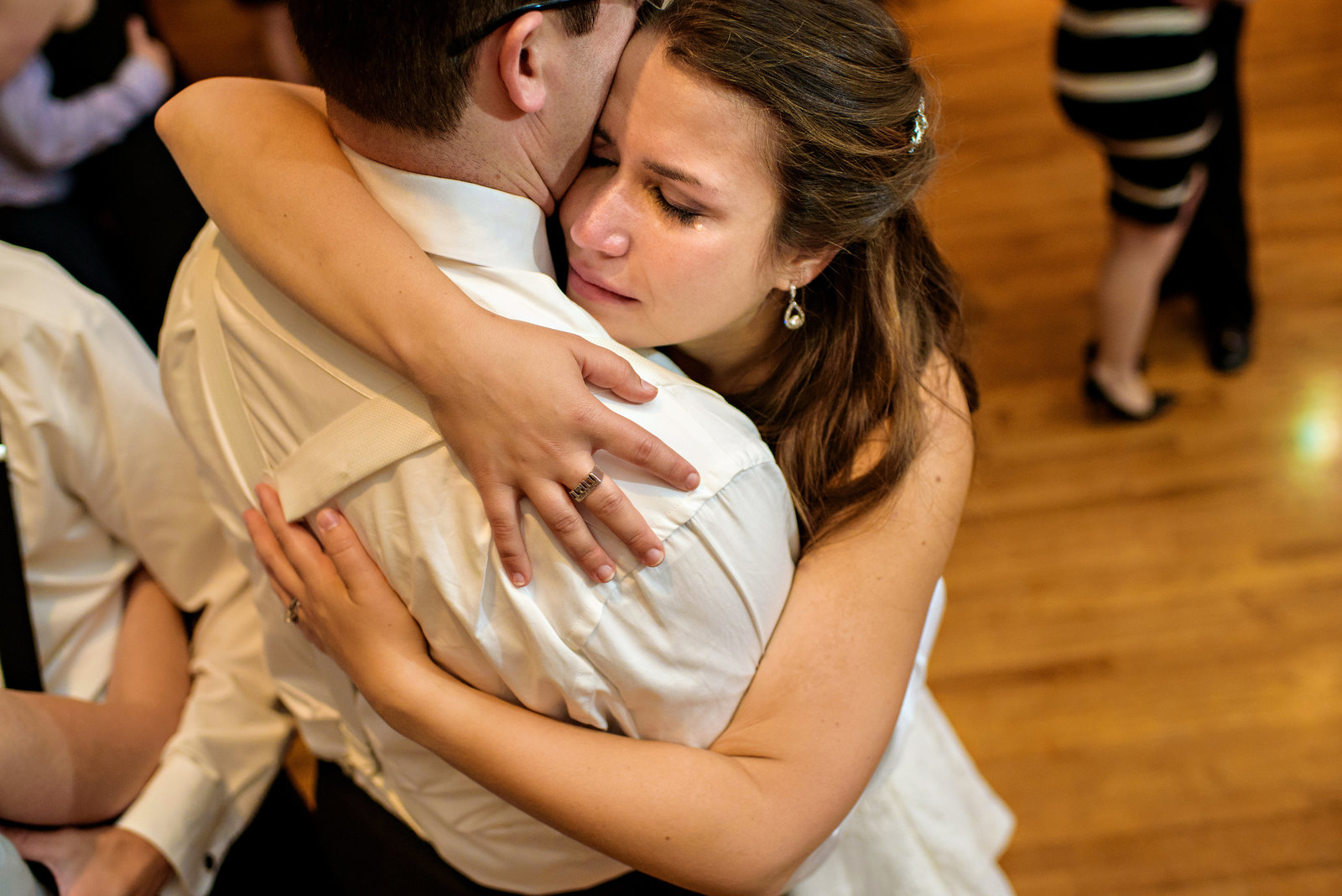 A bride sheds a tear during the last dance of the night with her groom.