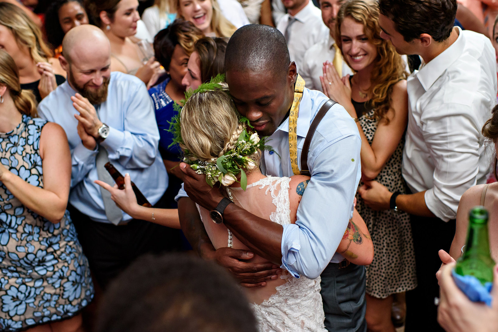 A loving embrace from a groom to his bride during the last song at their reception in Baltimore, MD.