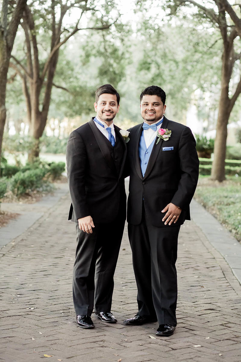 Groom and groomsmen stand under trees at Waterfront Park, South Carolina