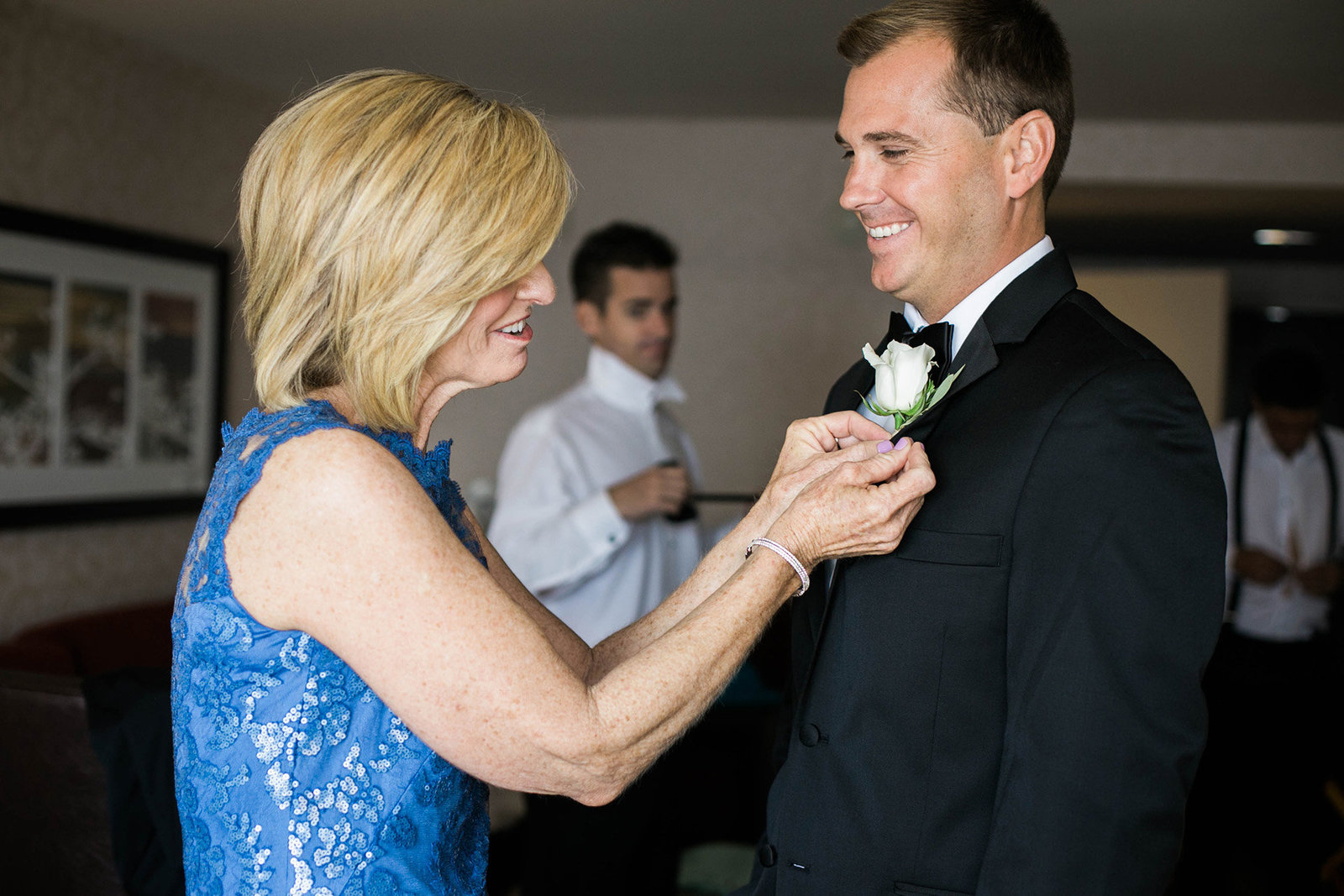 groom getting ready with mom