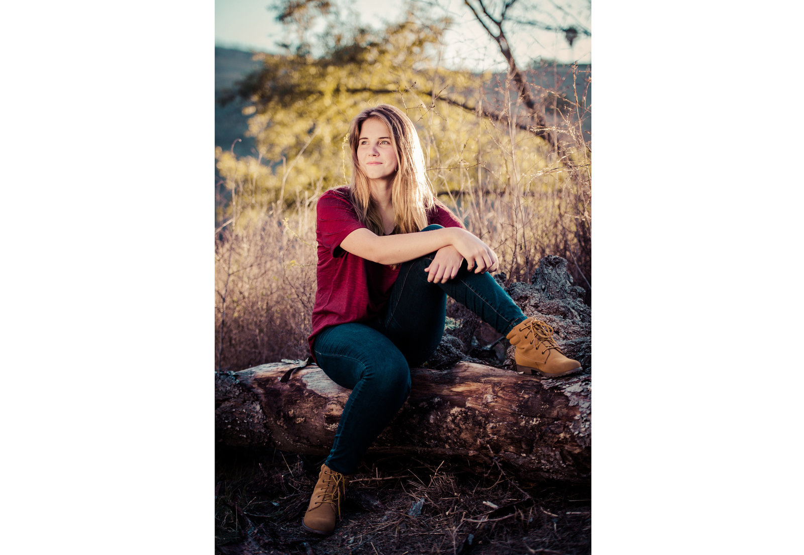 teenager posing for high school senior photos in Laguna Niguel Regional Park