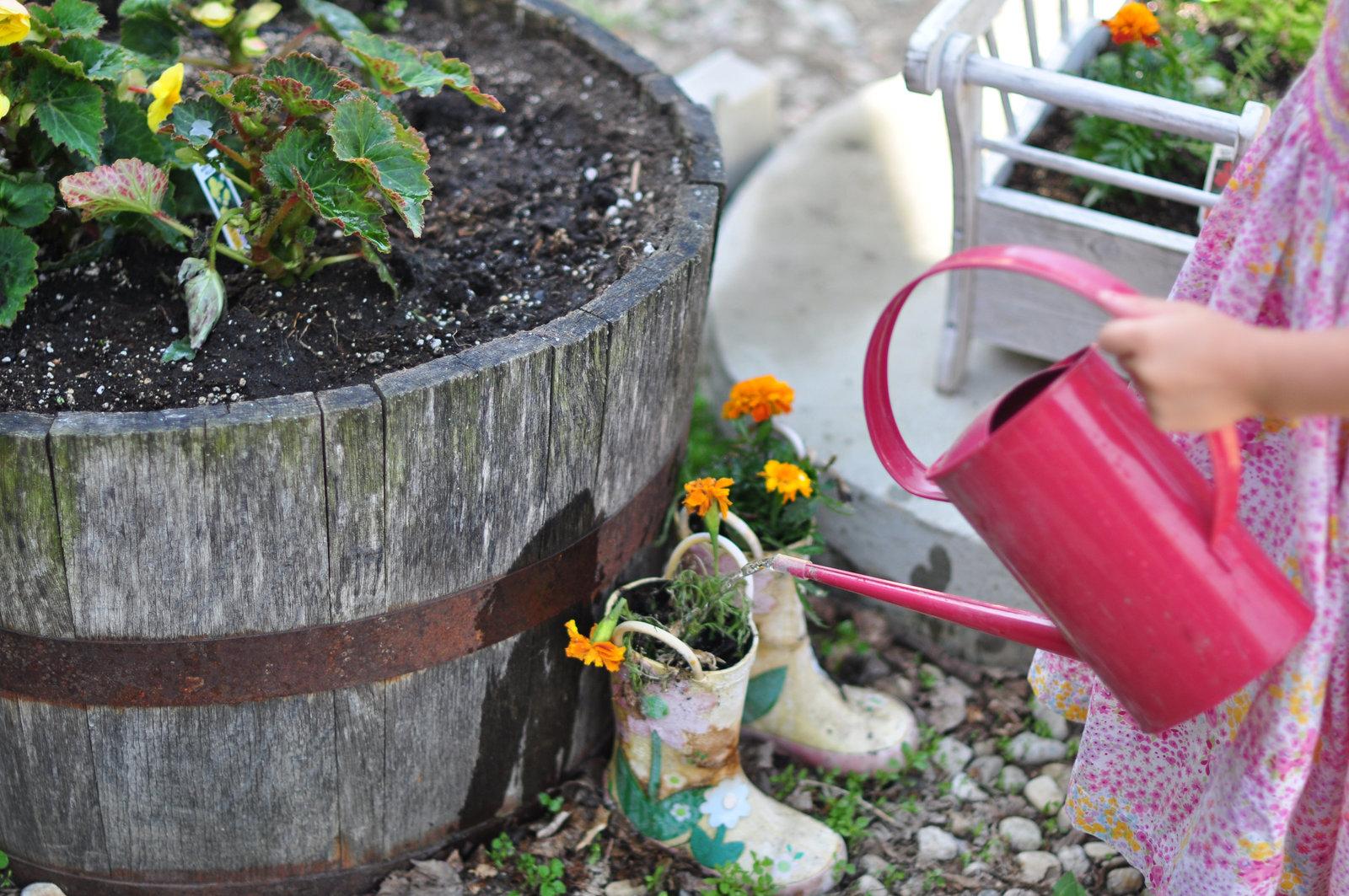 Watering a Garden little girl by Melissa E Earle Mee