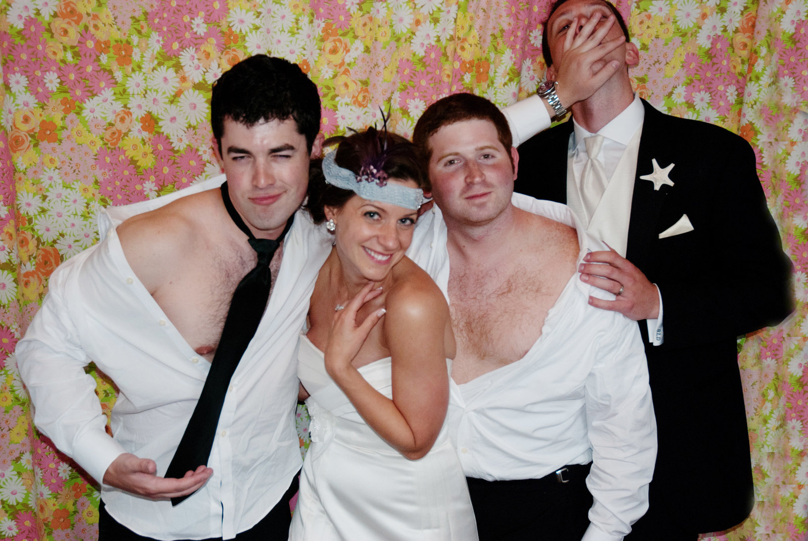 groomsmen steal away the bride in photobooth