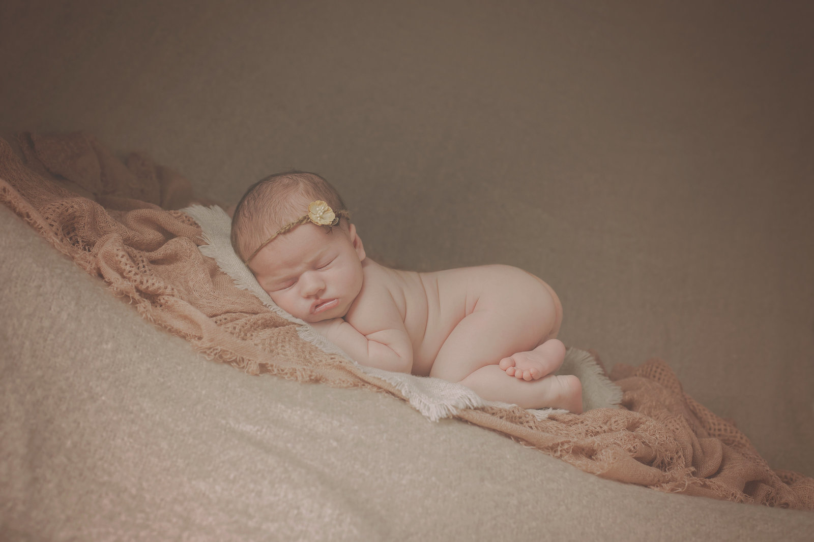 poughkeepsie newborn baby girl sleeping on fabric layers on mohair blanket with small headband naked by Hudson Valley professional photographer Autumn Photography photo studio in Cornwall NY