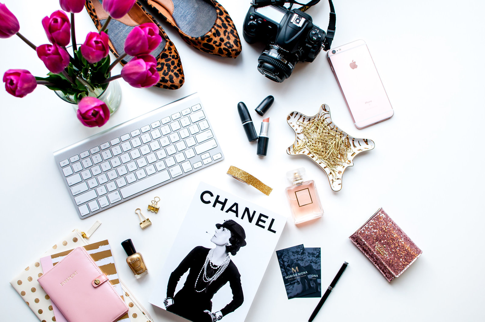 Custom styled stock photography for bosslady branding. Leopard print shoes, pink tulips, nikon camera, chanel perfume, passport and chanel book