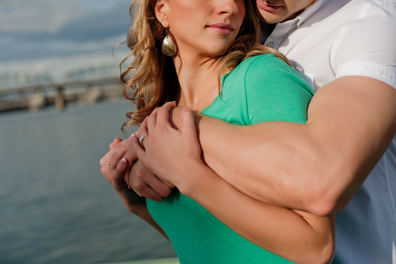 a guy with muscles embraces his fiance