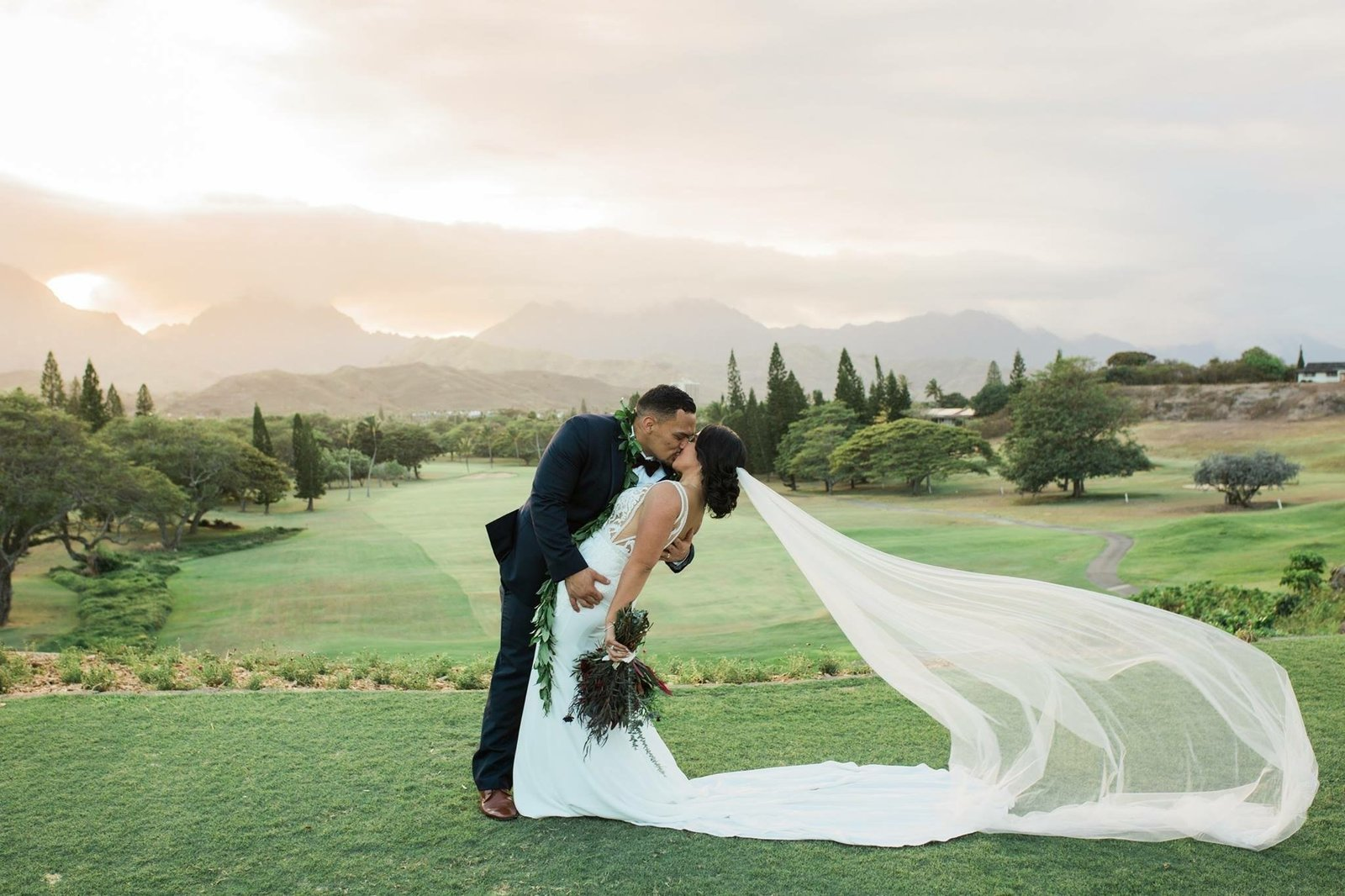 Sunset wedding at Mid Pacific Country Club in Hawaii