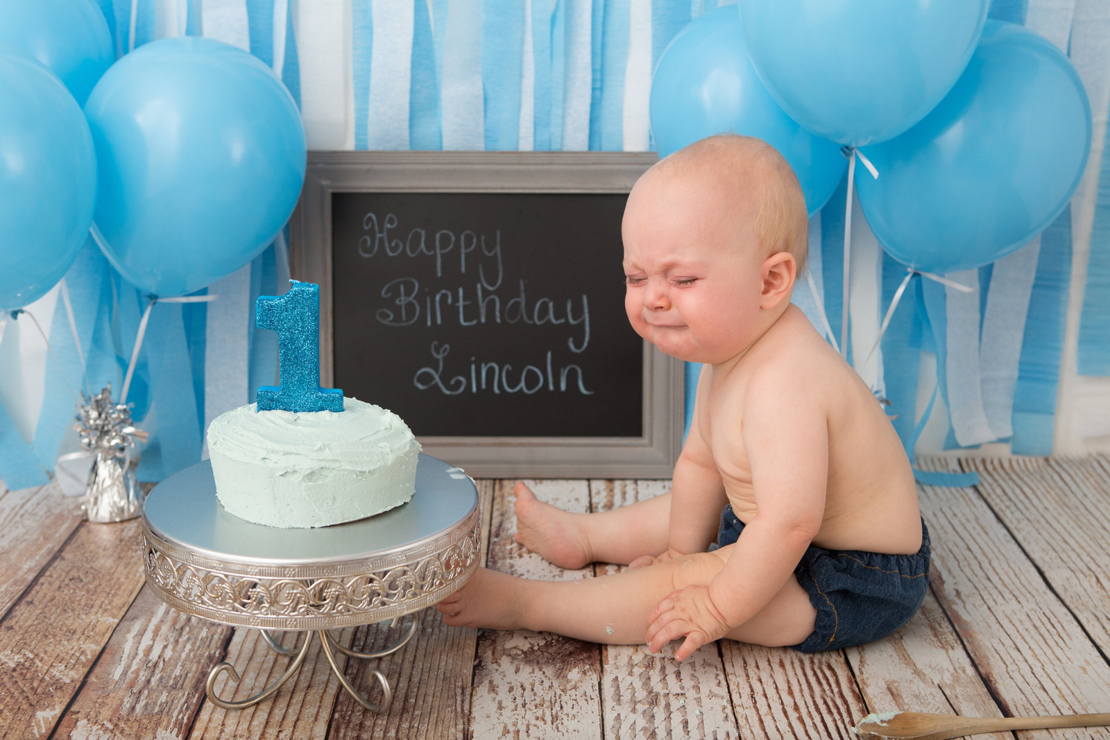 crying baby first birthday cake smash photos west point baby photographer in the Hudson Valley NY