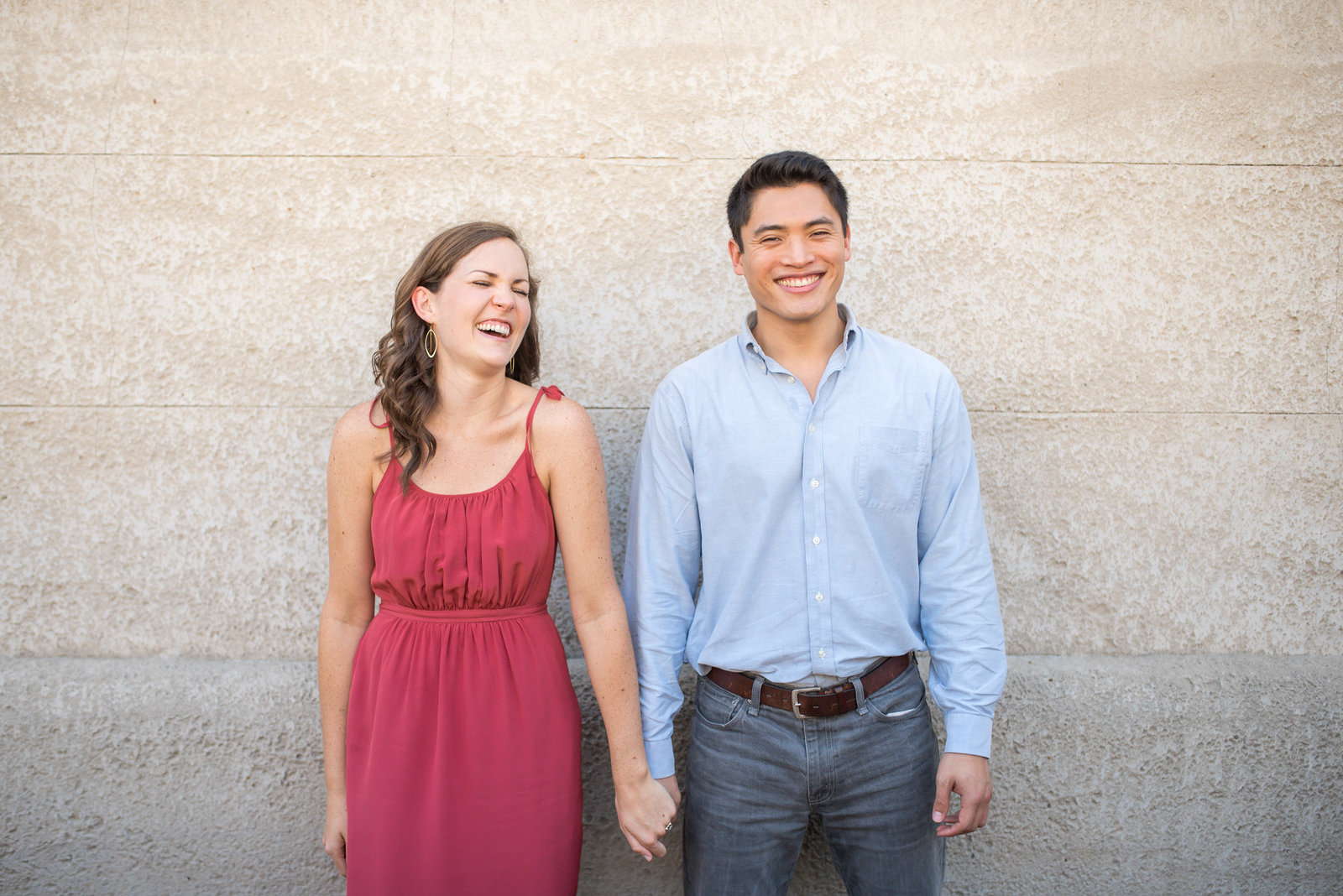 fun engagement photography couple laughing