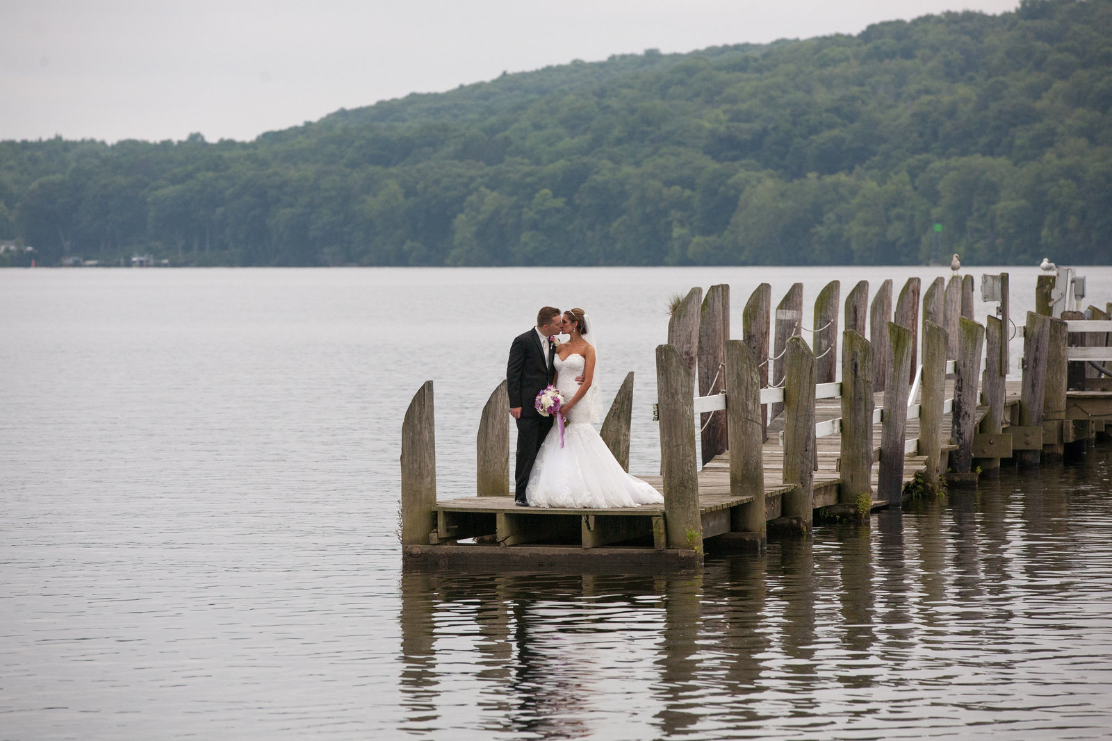 Bride and groom on a dock in a CT Wedding