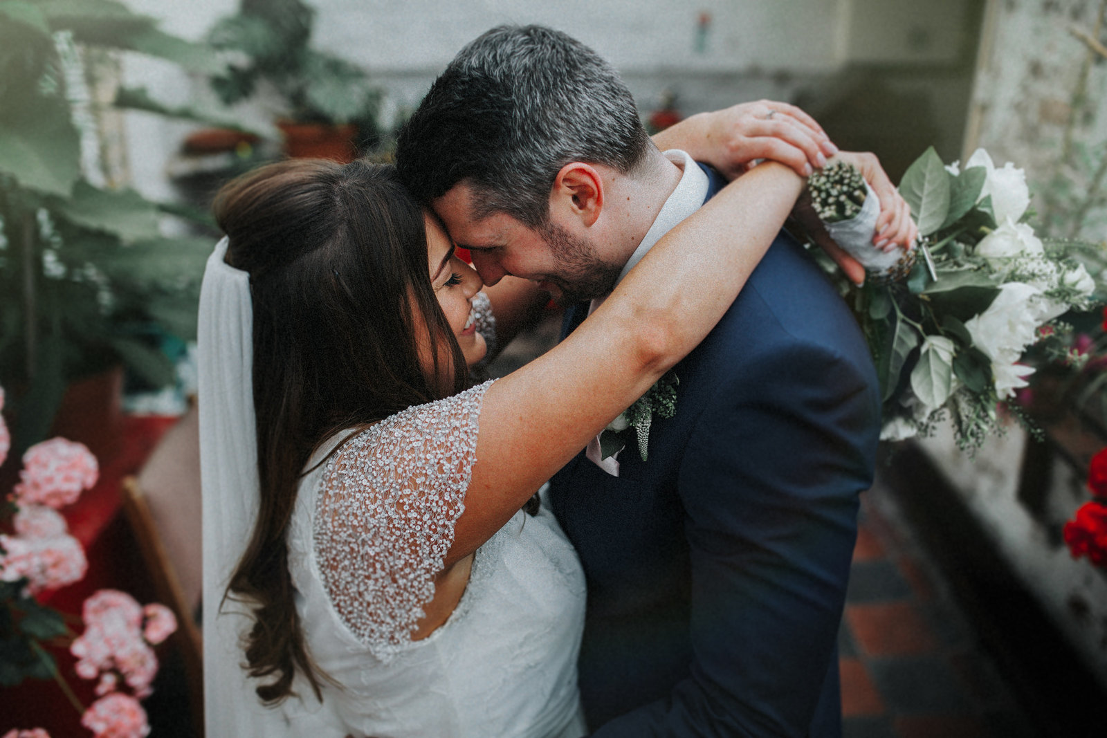Bride with arms around grooms neck resting heads together by Liverpool Wedding Photographer Jono Symonds
