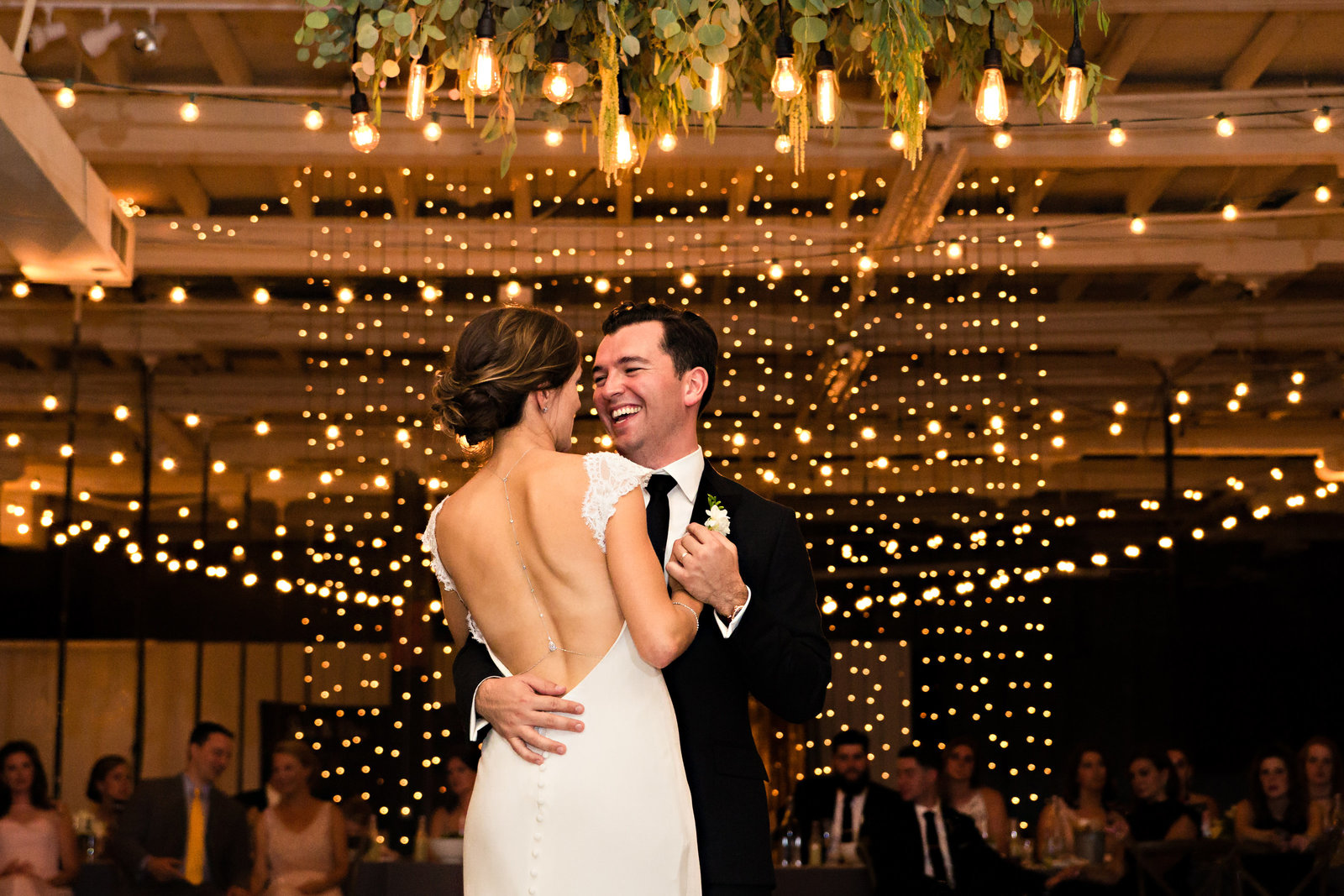 Portland Maine Wedding Photographers Reception First Dance String Lights Urban Industrial Bride Groom Photo