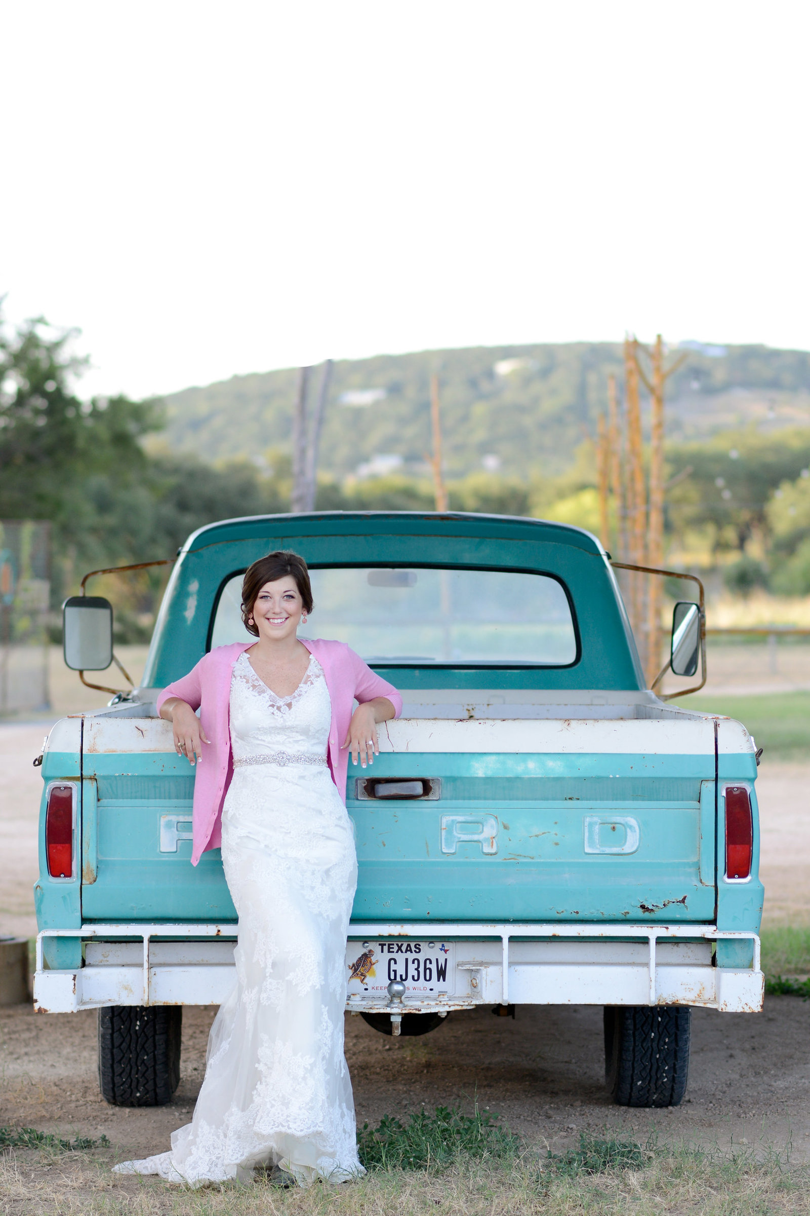 Montesino Ranch Vintage truck bridals with bride wearing pink cardigan