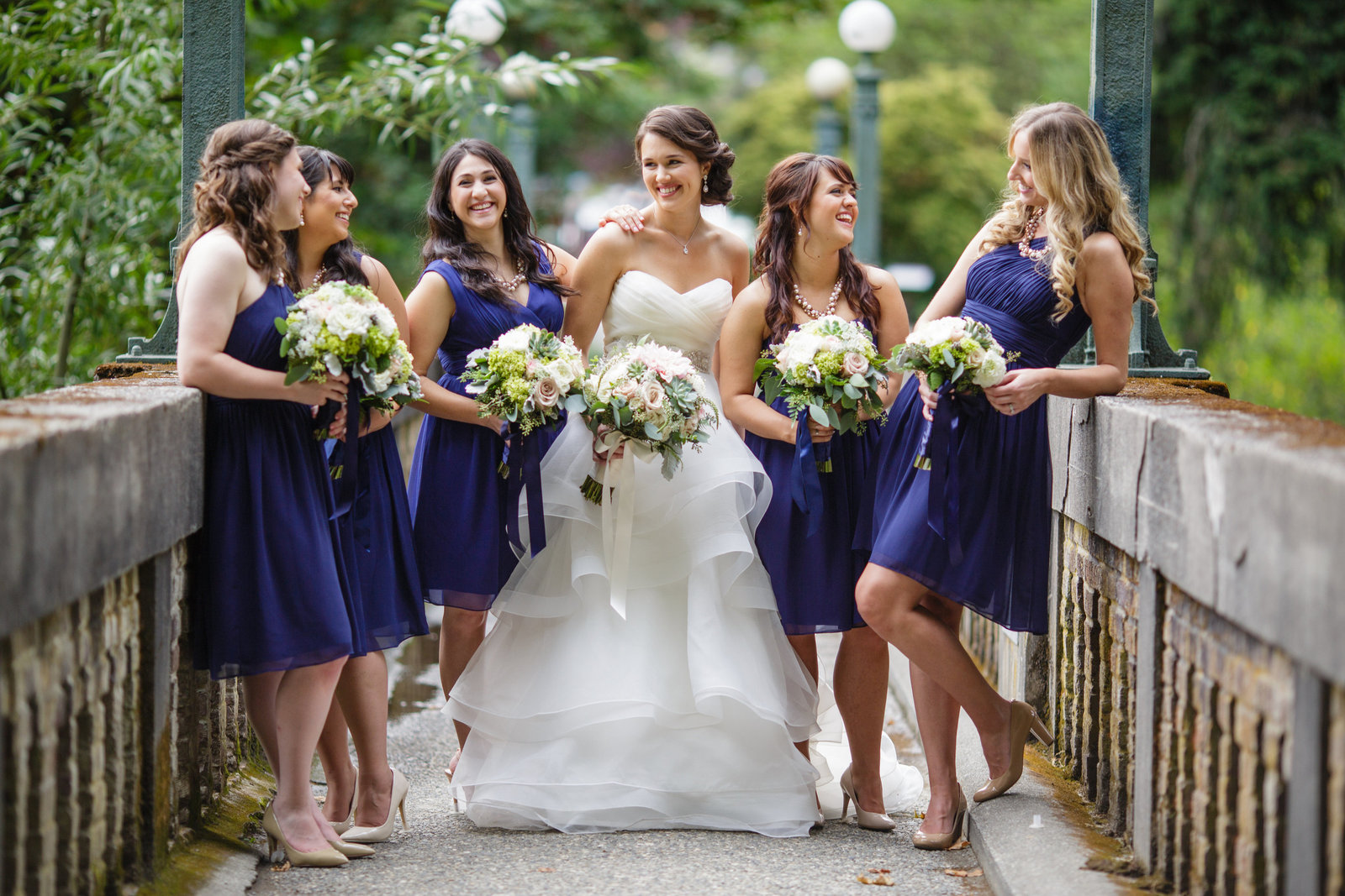 beautiful bridal party on bridge in atlanta