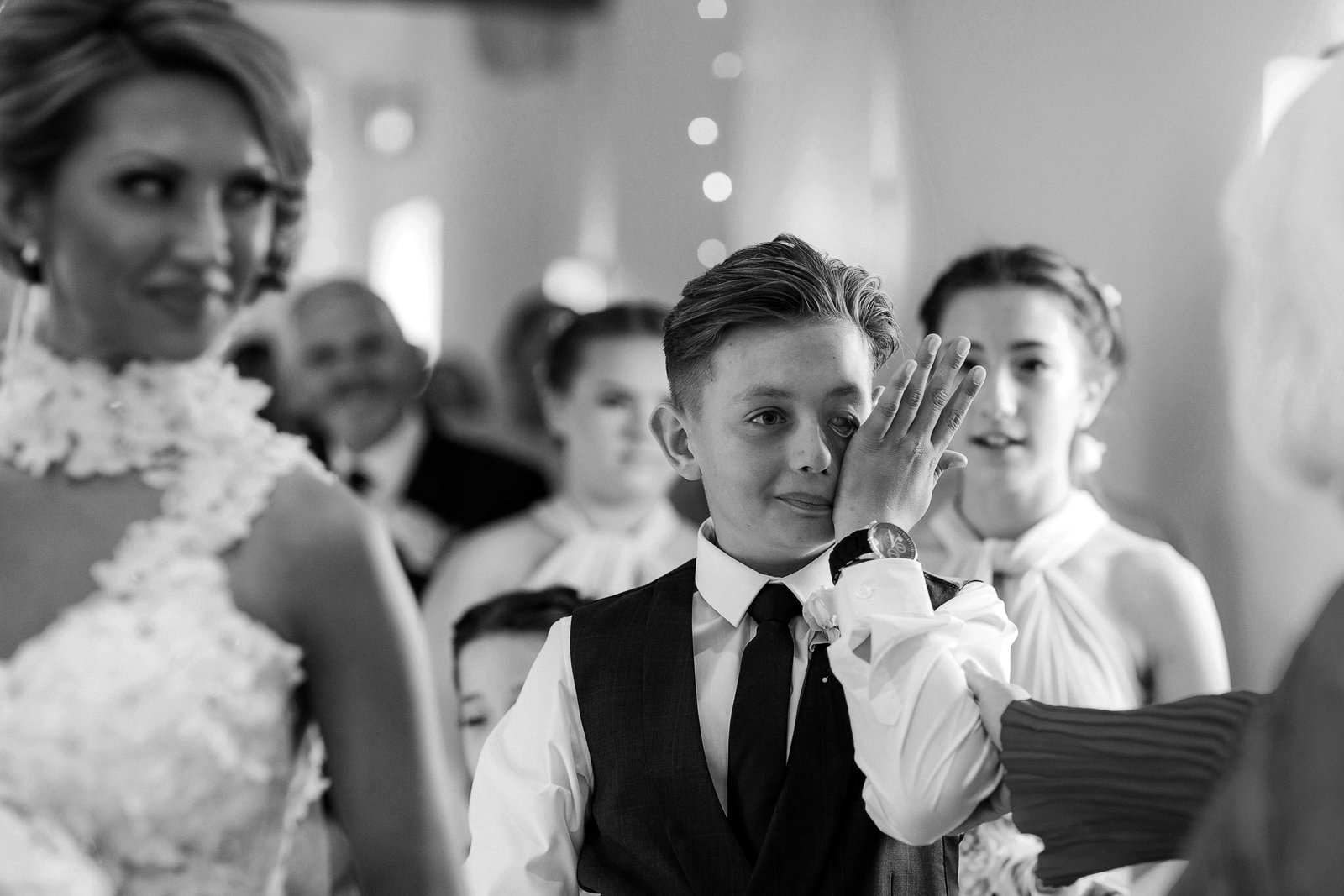 Son of the bride weeps with happiness and pride  when giving his mum away at her wedding during this Southend Barns Wedding ceremony captured by Nicci at Adorlee Photography