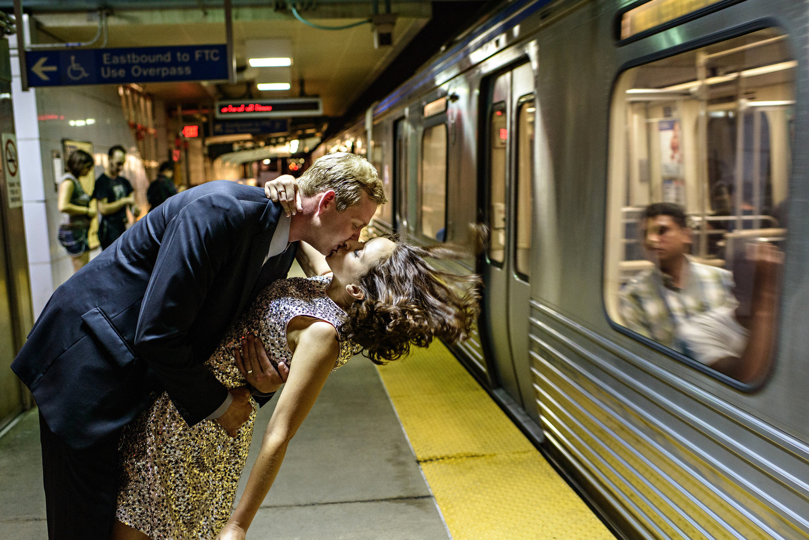 A wedding couple wait for the subway after their reception at Front & Palmer.