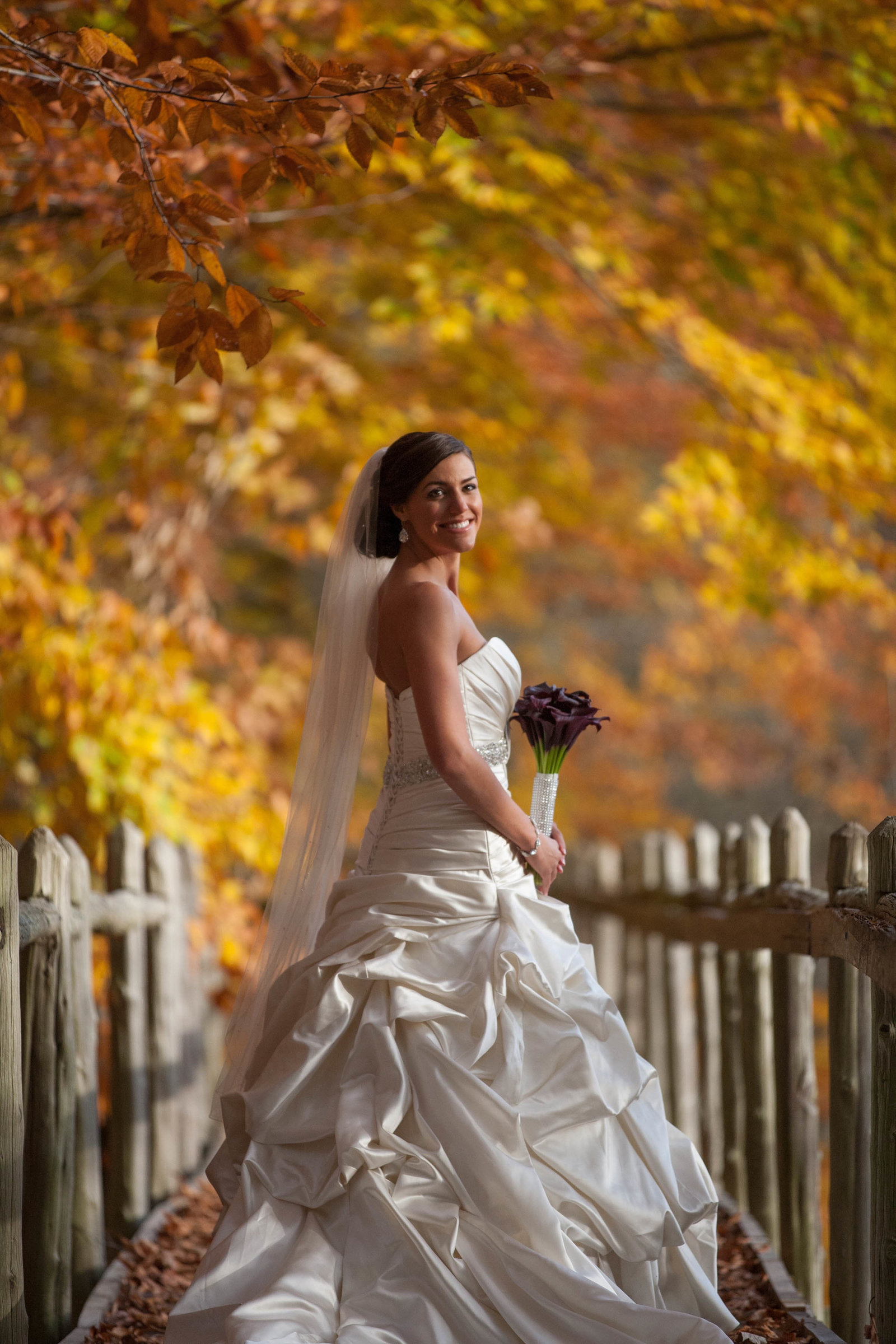 bride standing on bridge