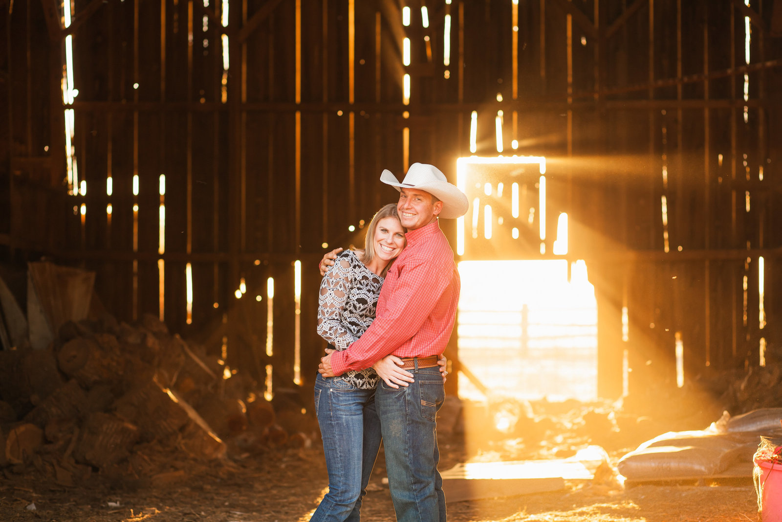 Lincoln engagement session couple in barn at sunset golden hour, country