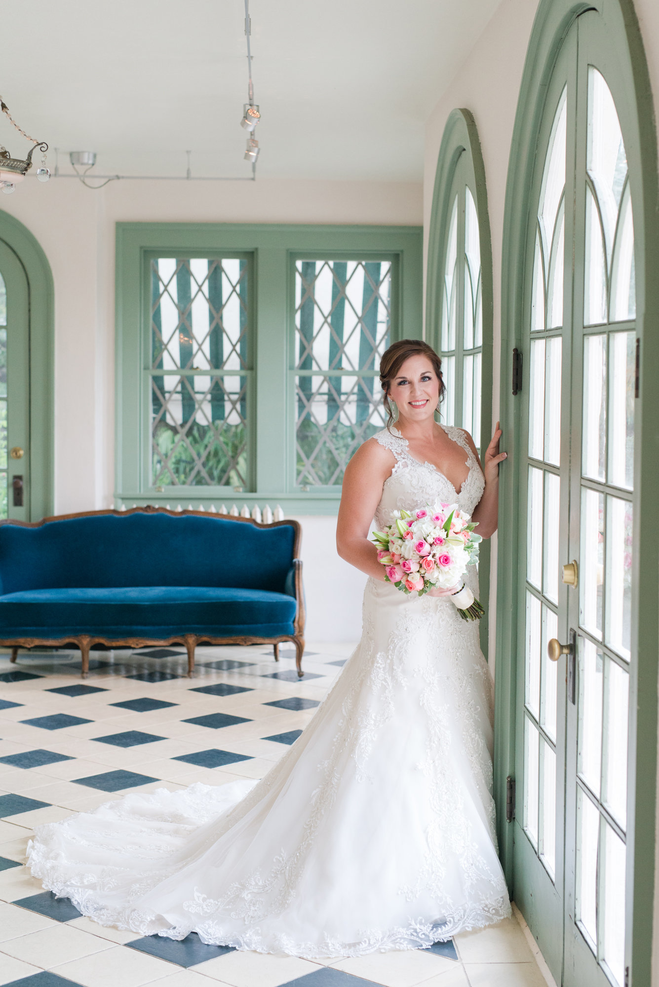 Bride in Maggie Sottero Gown smiles for bridal portraits at Laguna Gloria in Austin, Texas Driscoll