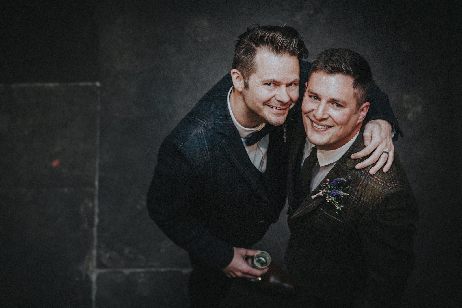 Grooms looking up smiling - LGBT Wedding Photographer - Jono Symonds