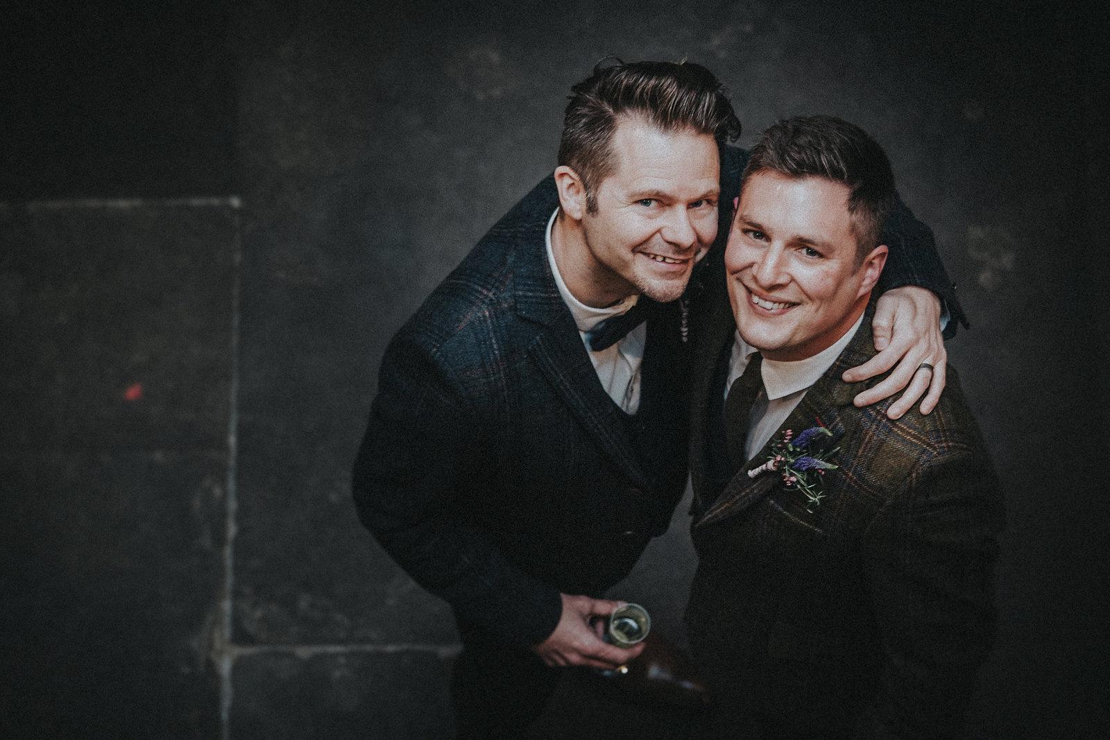 Grooms looking up smiling - LGBT Wedding Photographer - Jono Symonds