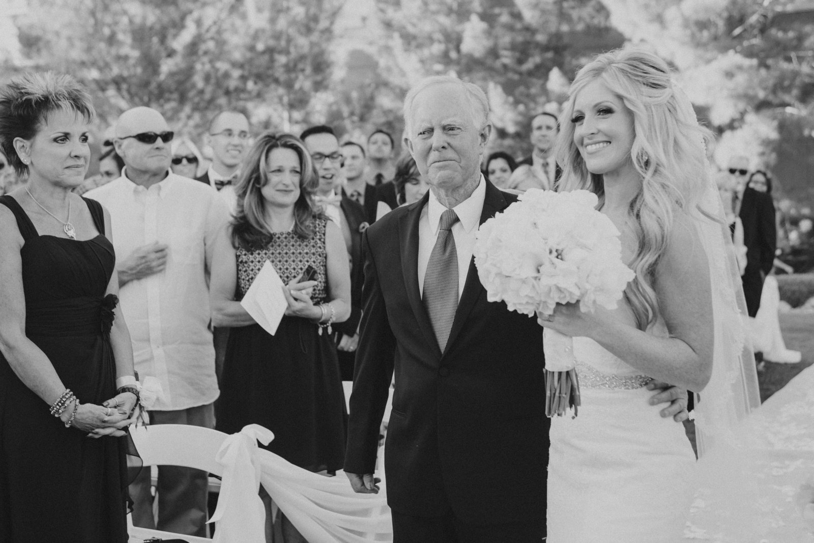 black and white photo of father giving away the bride | Susie Moreno Photography
