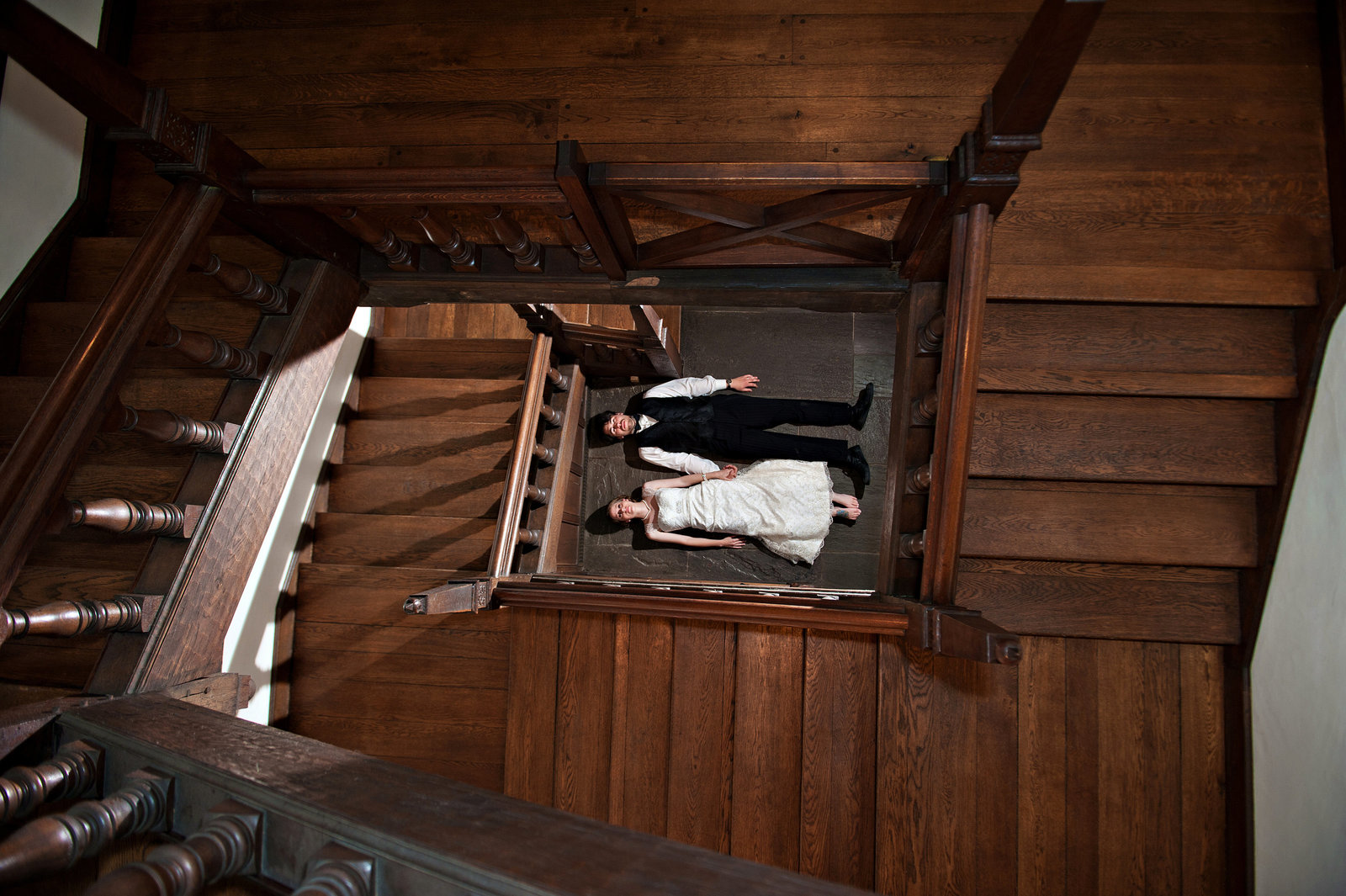 A wedding couple at the bottom of the staircase in Aldie Mansion Wedding.
