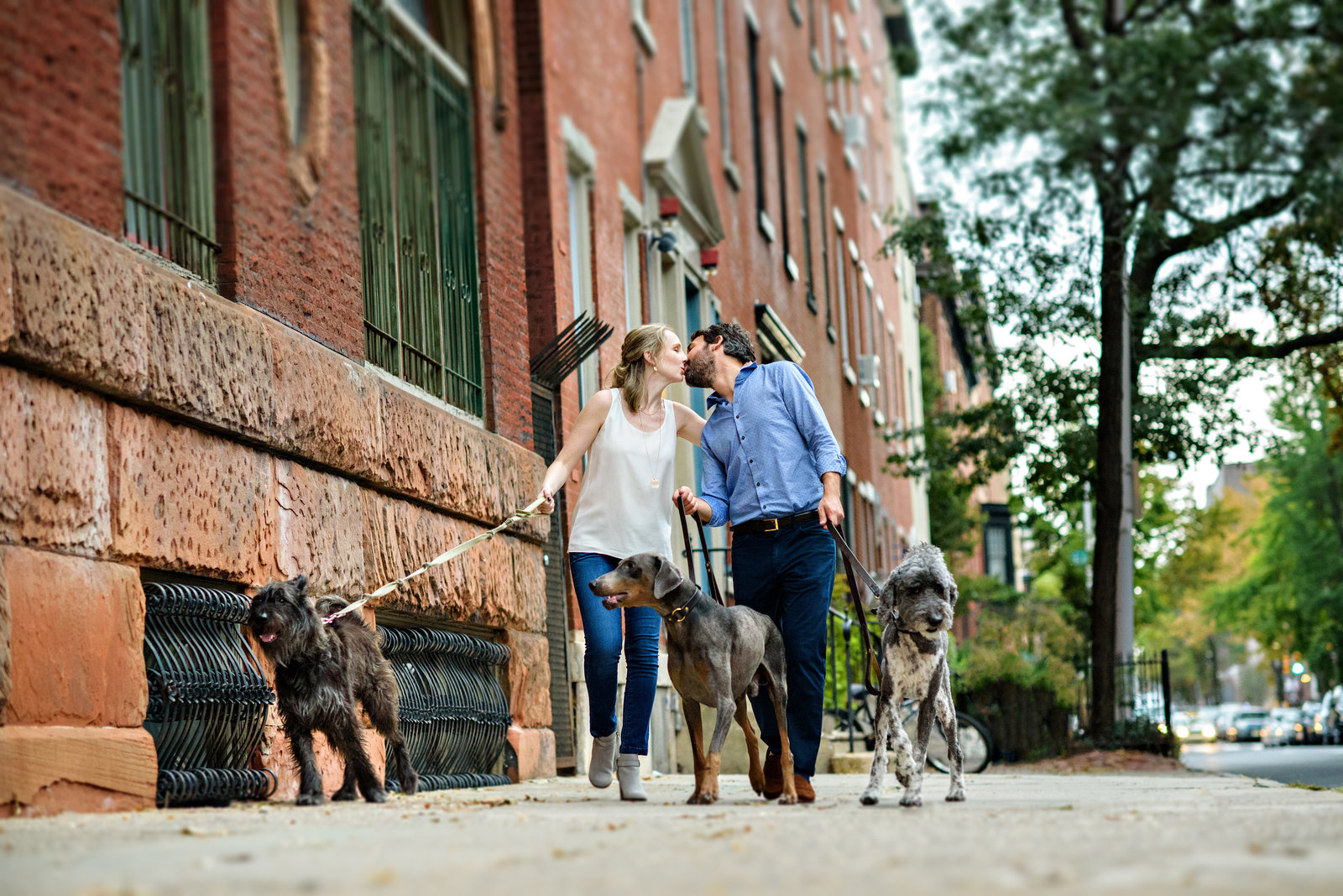 A fun philly couple walk their dogs.