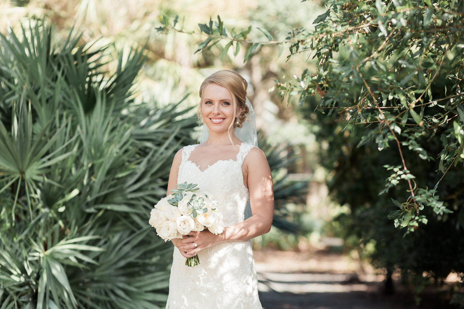 Bride stands by palm tree, Alhambra Hall, Mt Pleasant, South Carolina