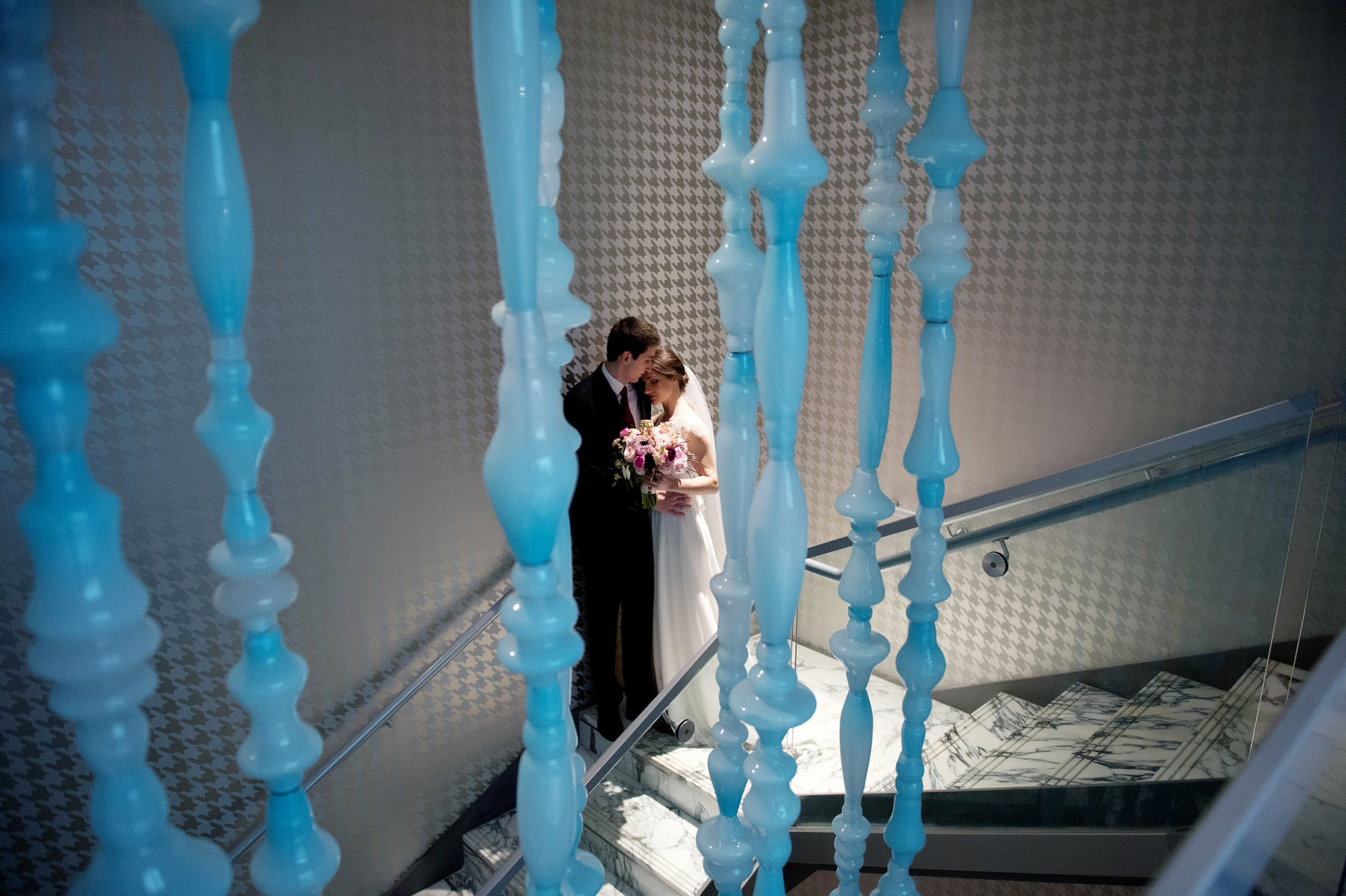 a couple kiss before their wedding at the nines hotel