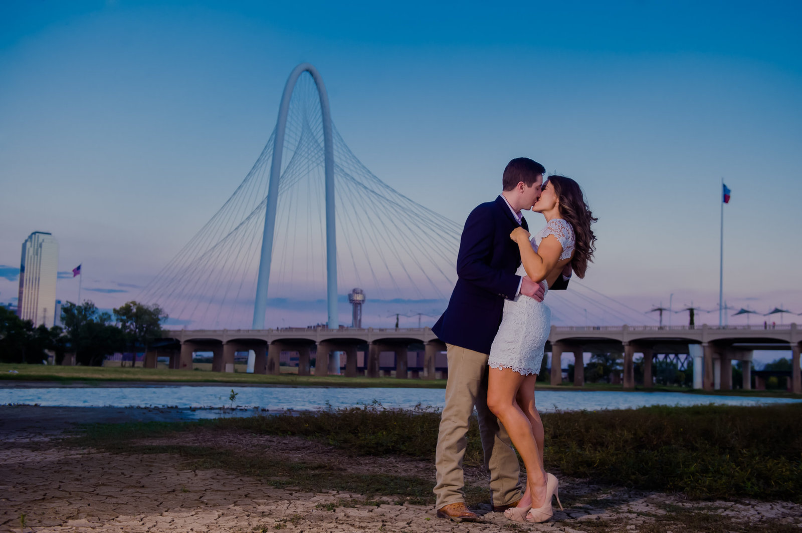Dallas engagement photo with bridge