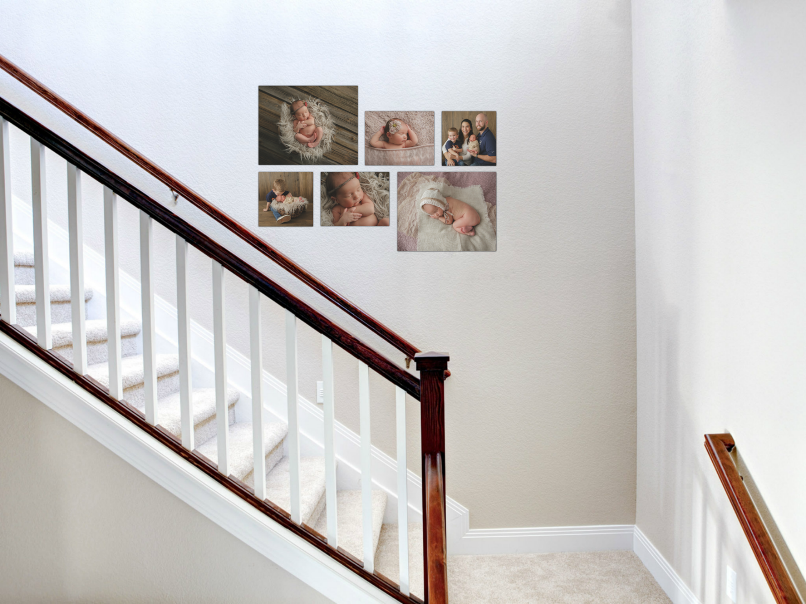 stairwell Canvas wall grouping cluster on stairs newborn photographer in the Hudson Valley located in Cornwall NY