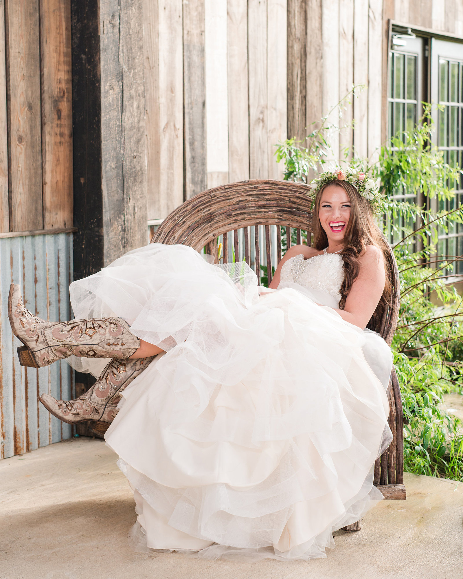 Bride lounges in woven chair of the Creek Haus in Dripping Springs, Texas