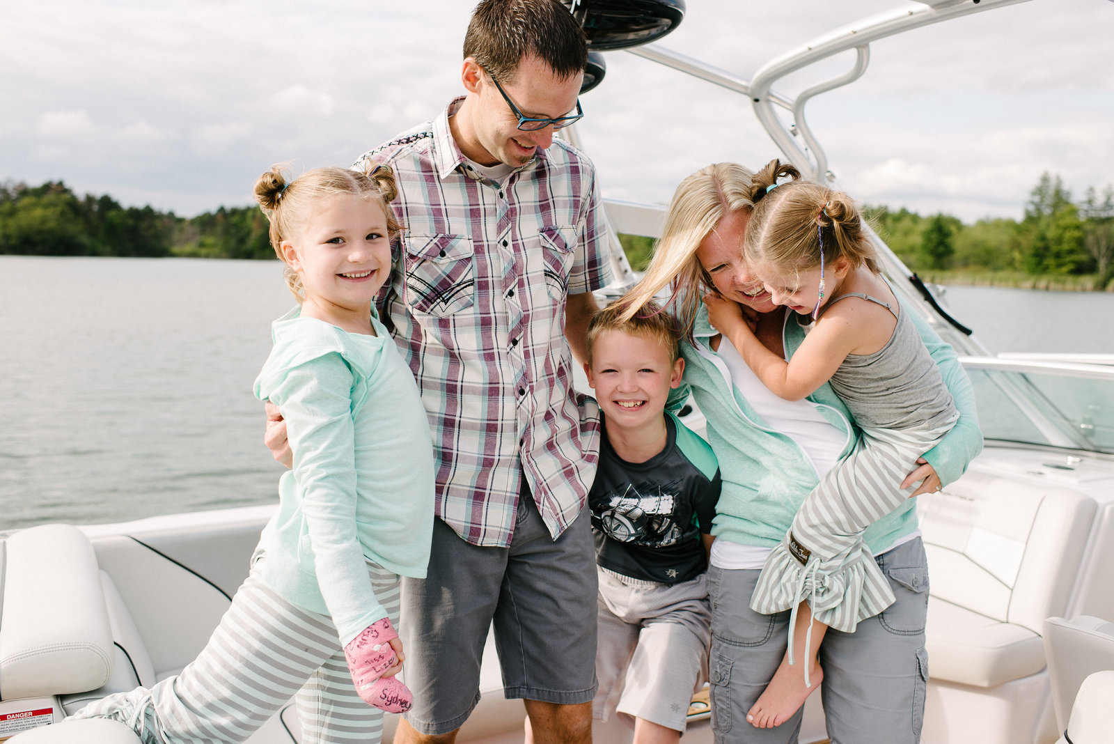 Columbiana OH family with three kids on boat at the lake