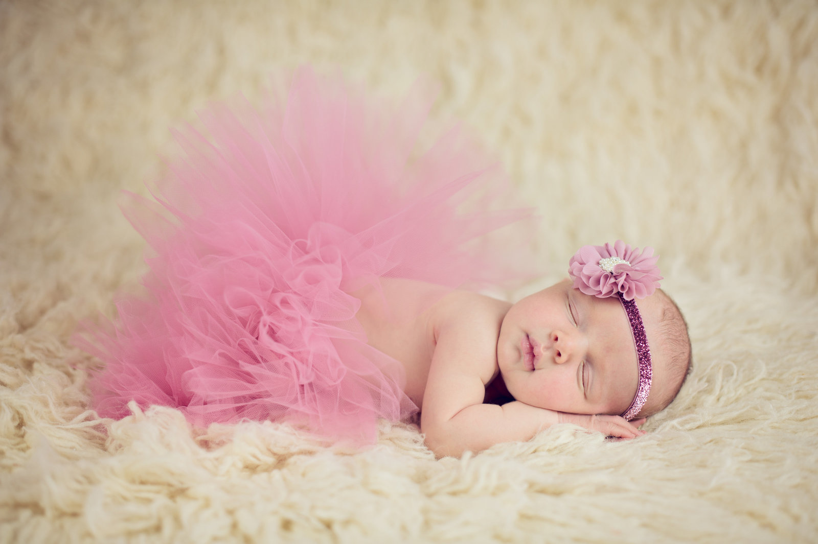 newborn with pink tutu and headband