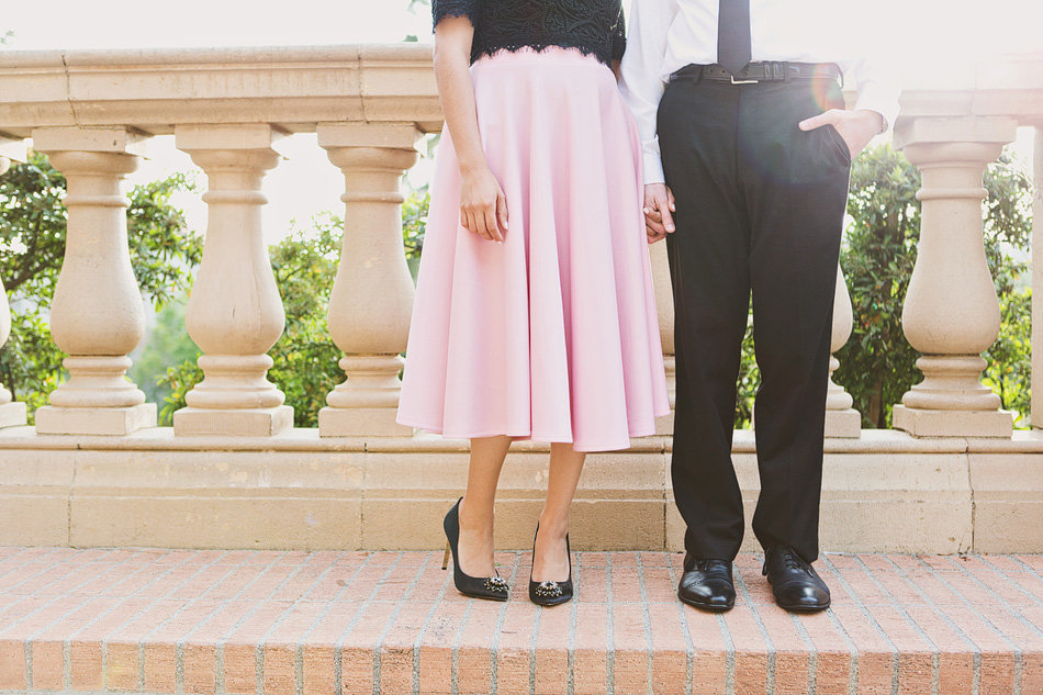 classy engagement photos with pink skirt