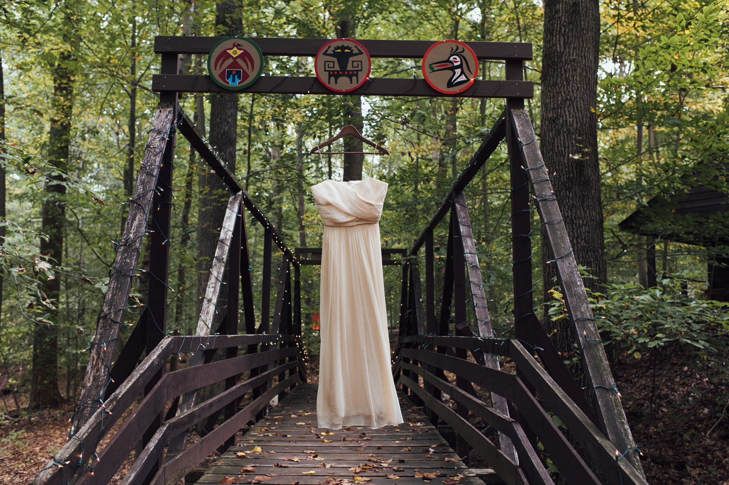rustic vintage wedding dress hangs at camp wedding near philly