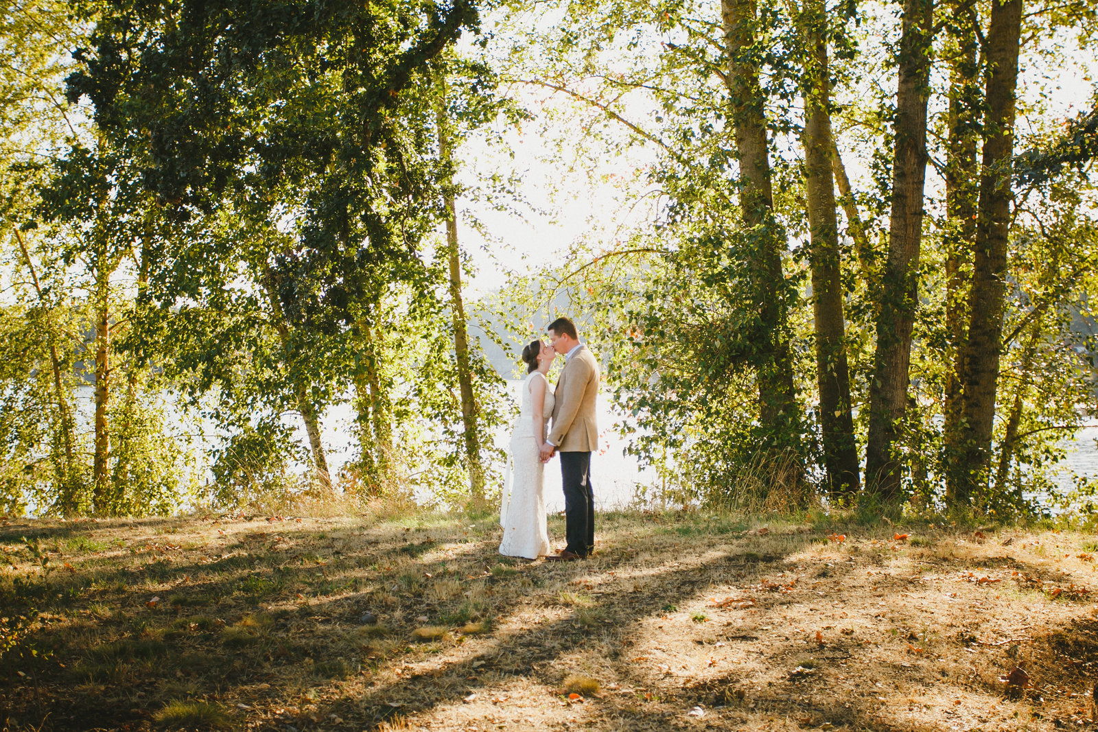 Outdoor Wedding Photos of bride and groom kissing