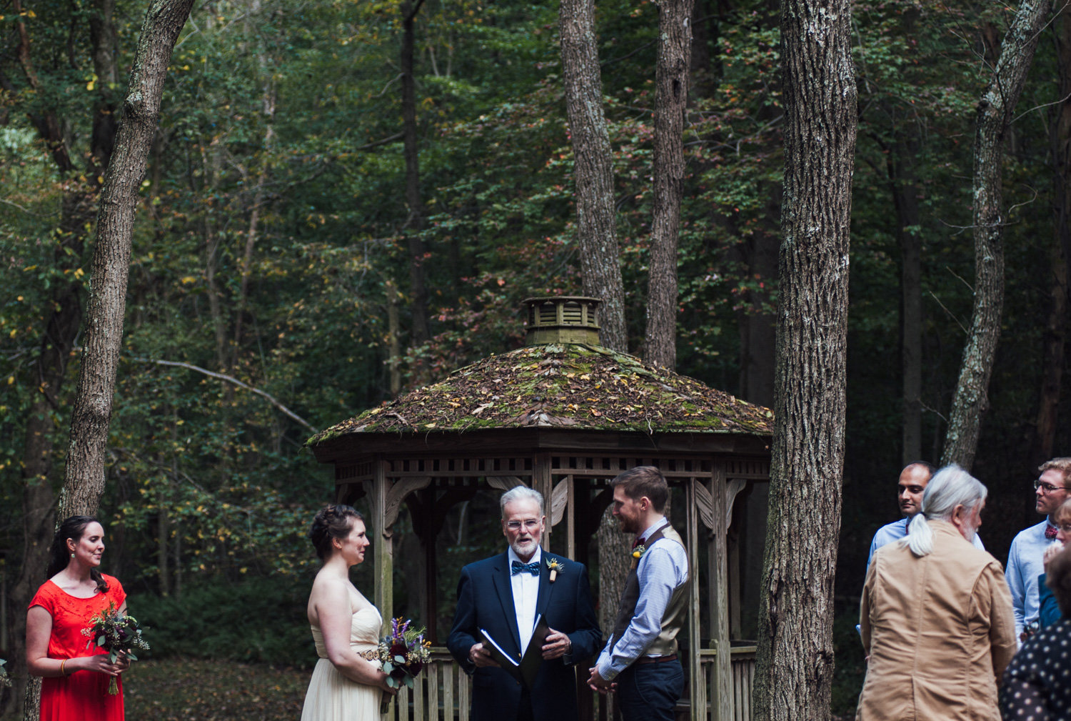 outdoor wedding ceremony at camp puh'tok maryland