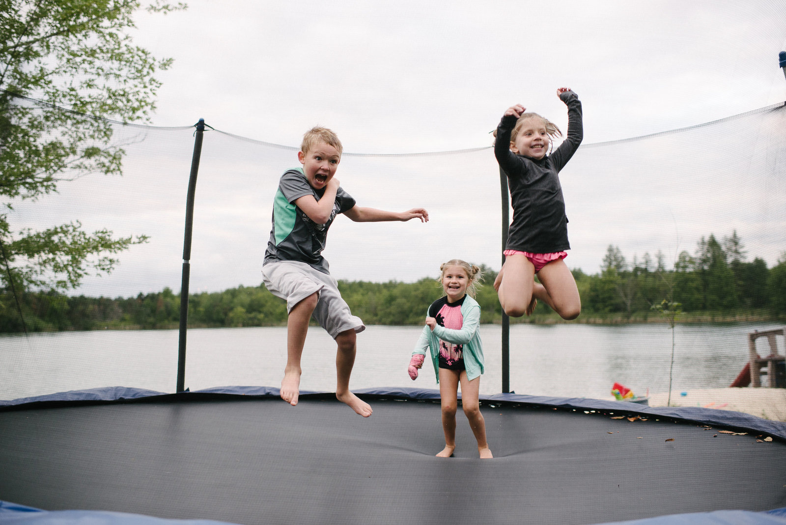 Youngstown OH kids jumping on trampoline at the lake
