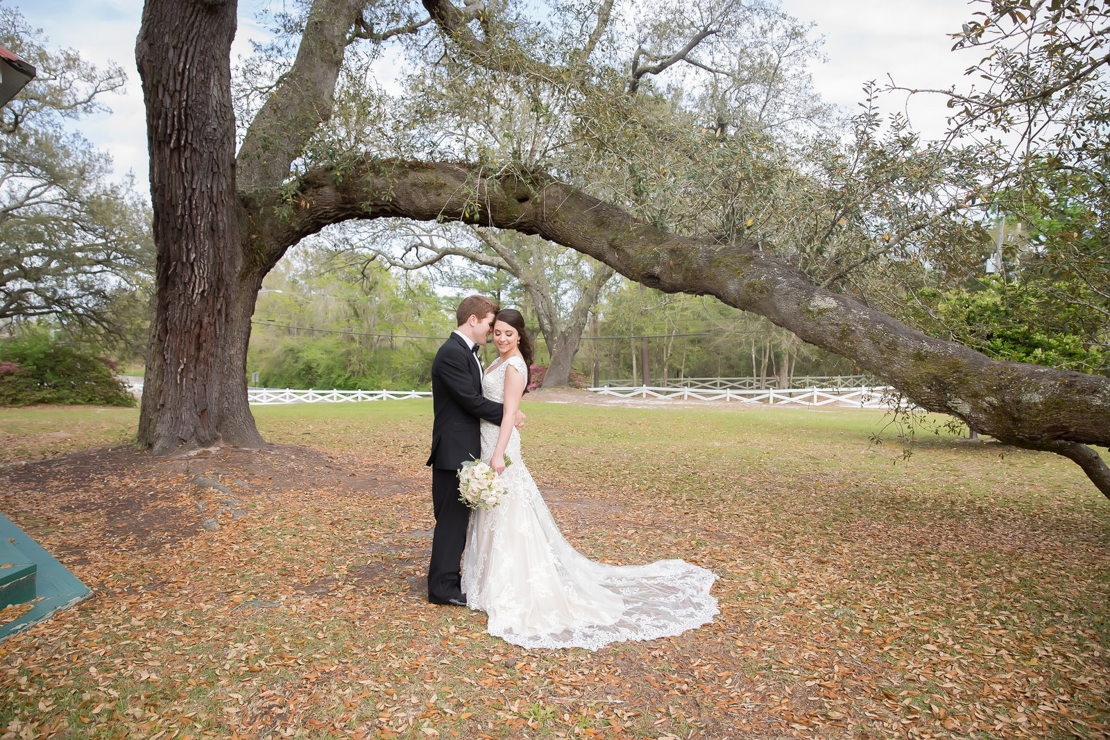 Bride and Groom at Oak Crest Mansion on wedding day in Pass Christian Mississippi
