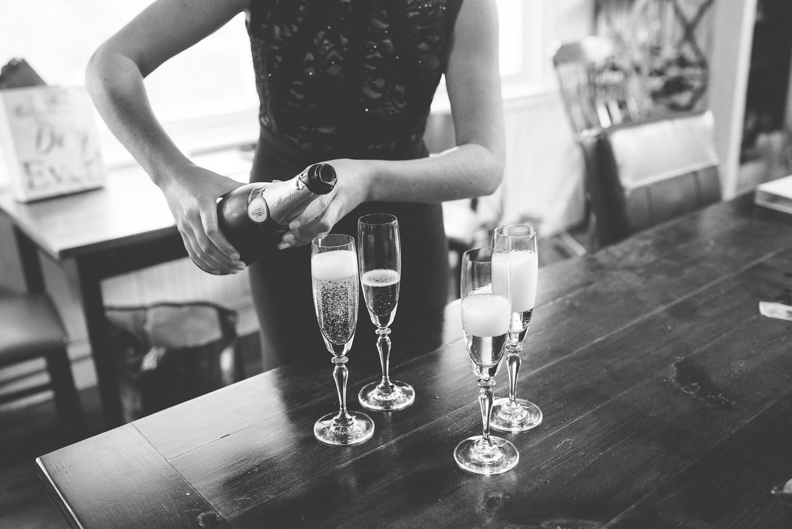 pouring champagne, black and white wedding photography, Vermont wedding photographer, documentary style wedding photography