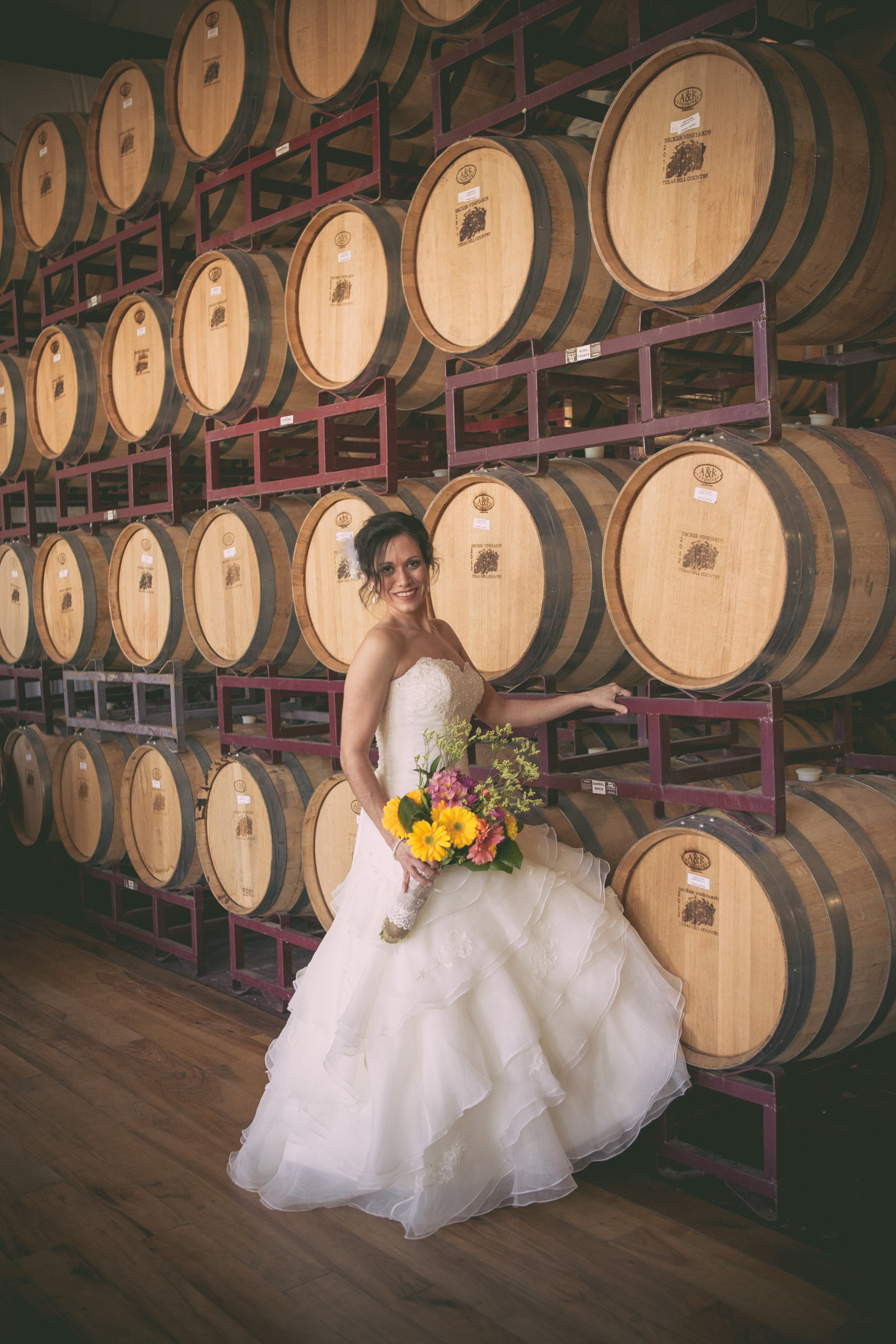 Austin Family Photographer, Tiffany Chapman, bride in barrel room photo