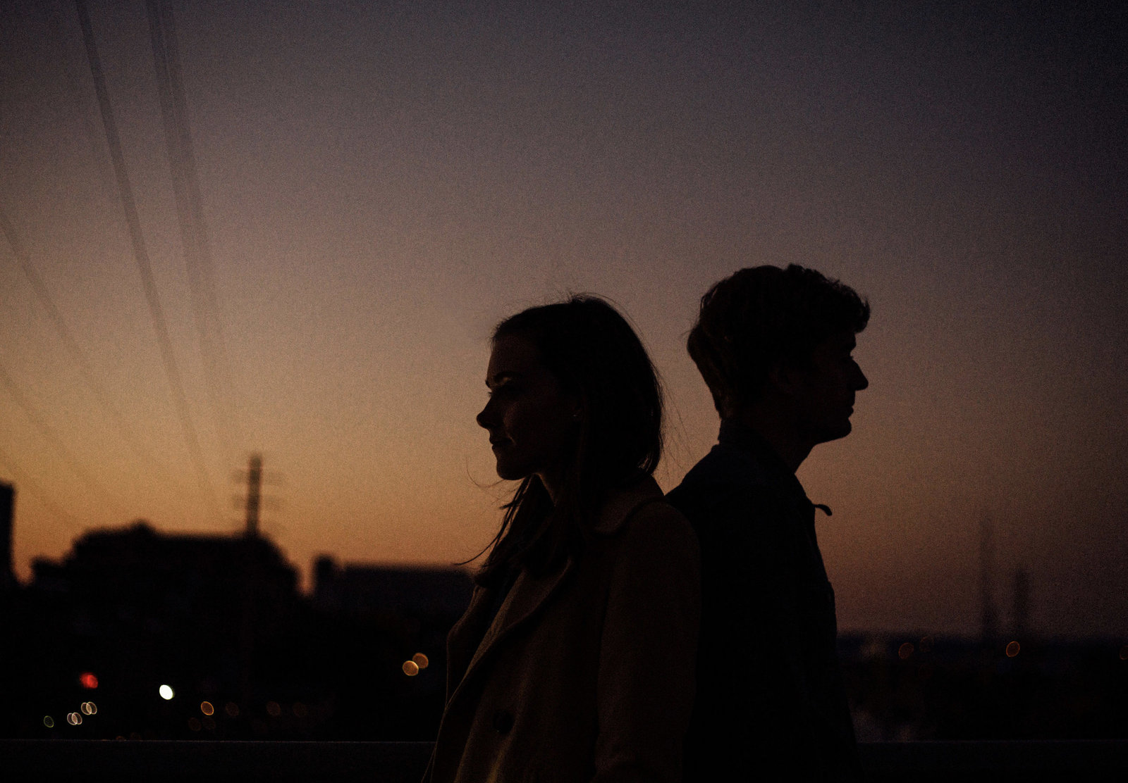 Silhouette of engaged couple in downtown Nashville
