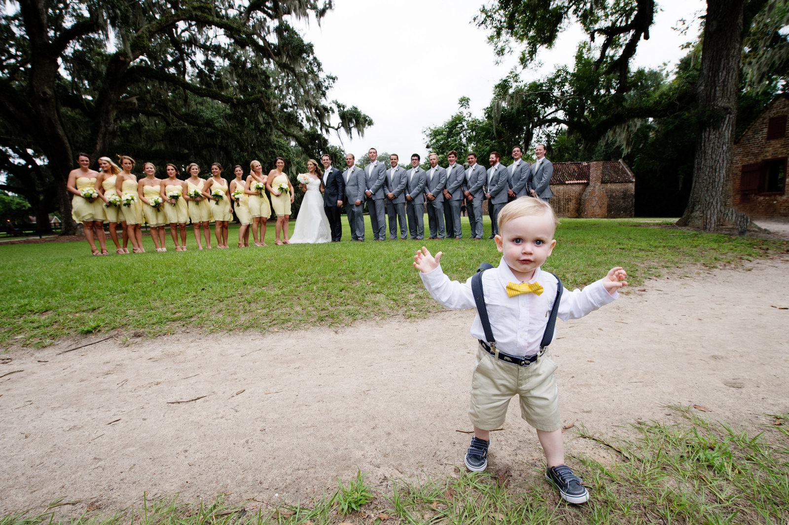 ring bearer runs away during wedding party portraits