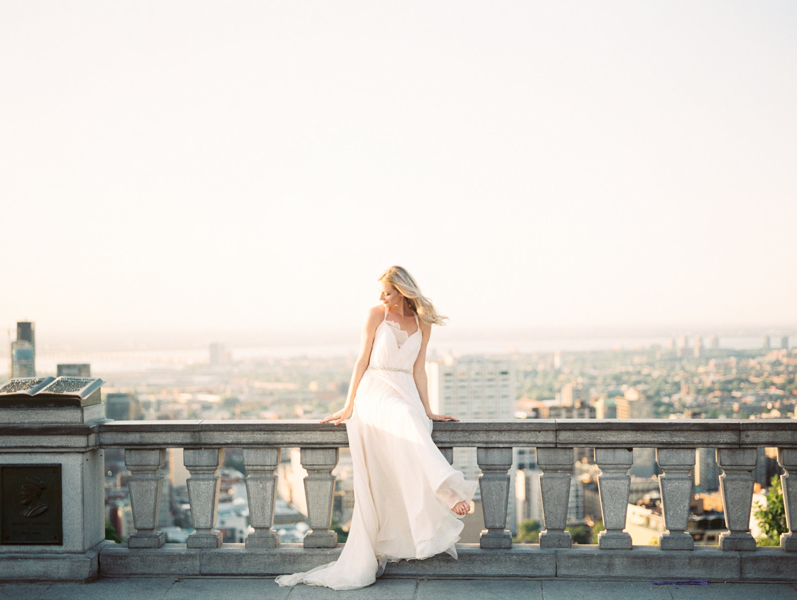 Toronto Bride sitting on rooftop ledge