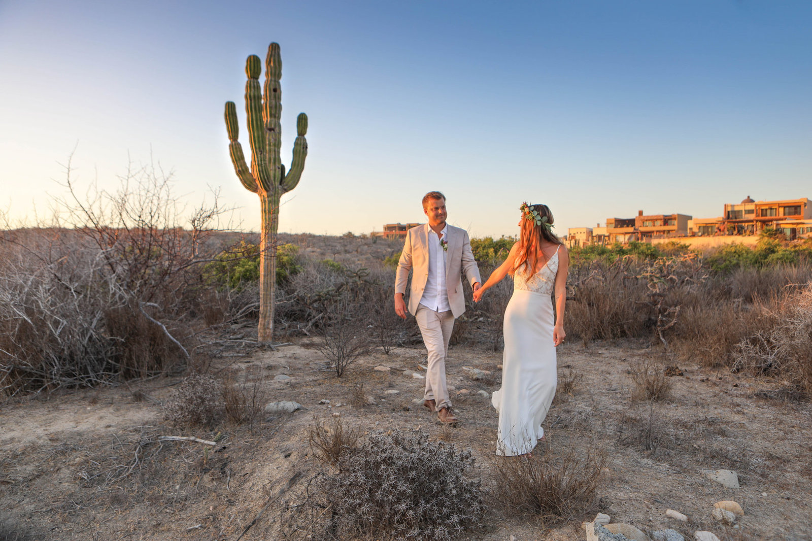 Stunning mexican desert provides beautiful backdrop for golden hour portrait of bride and groom